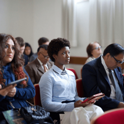 A church congregation meet together in a chapel learning about Jesus Christ