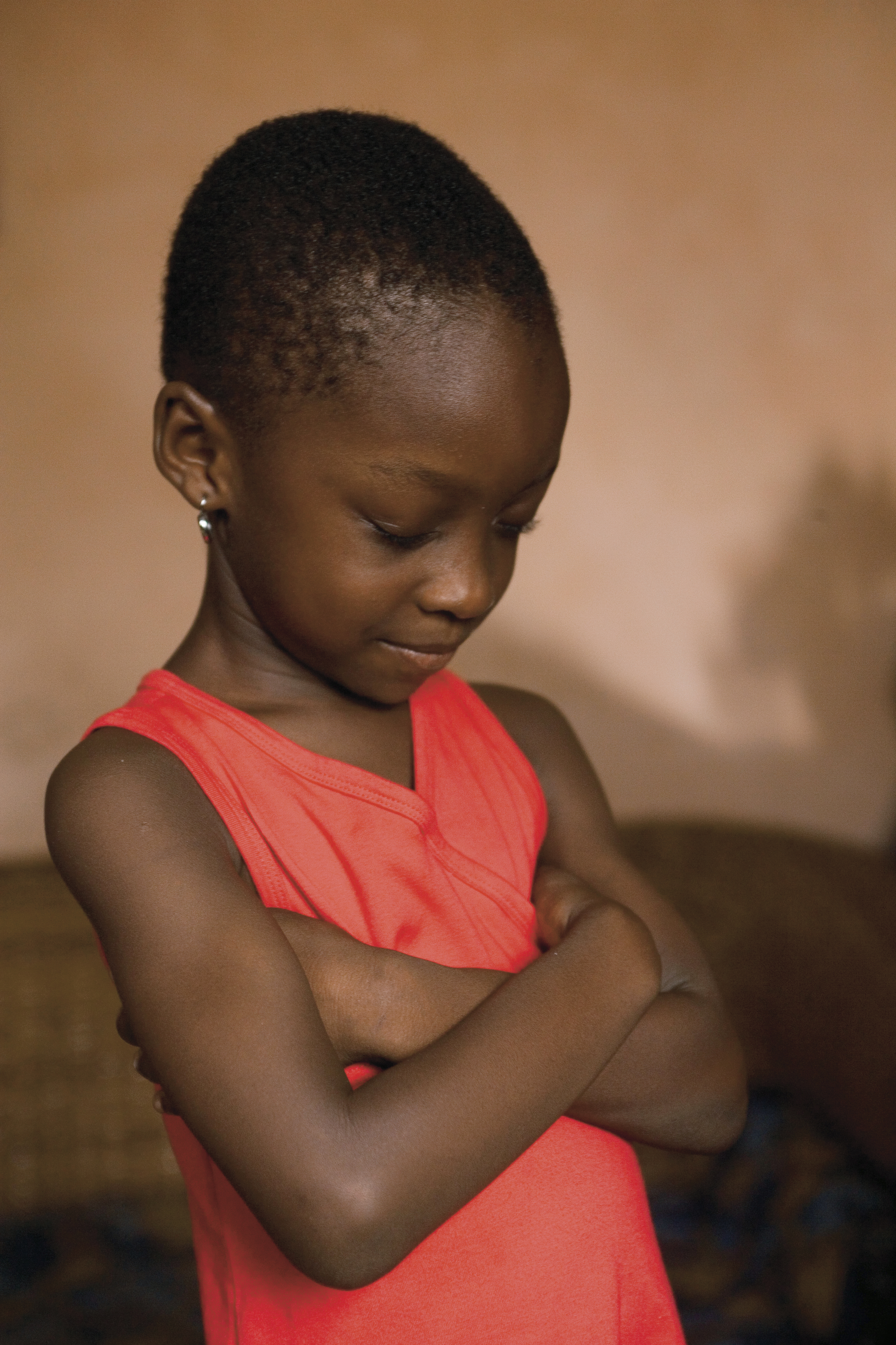 A girl from Ghana prays.