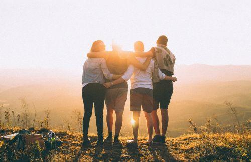 four friends watching sunset