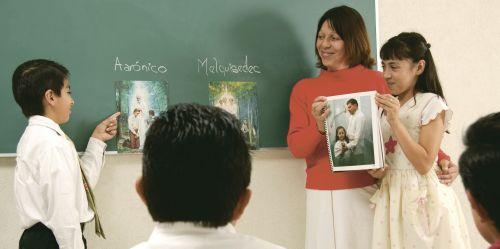 teacher and children standing