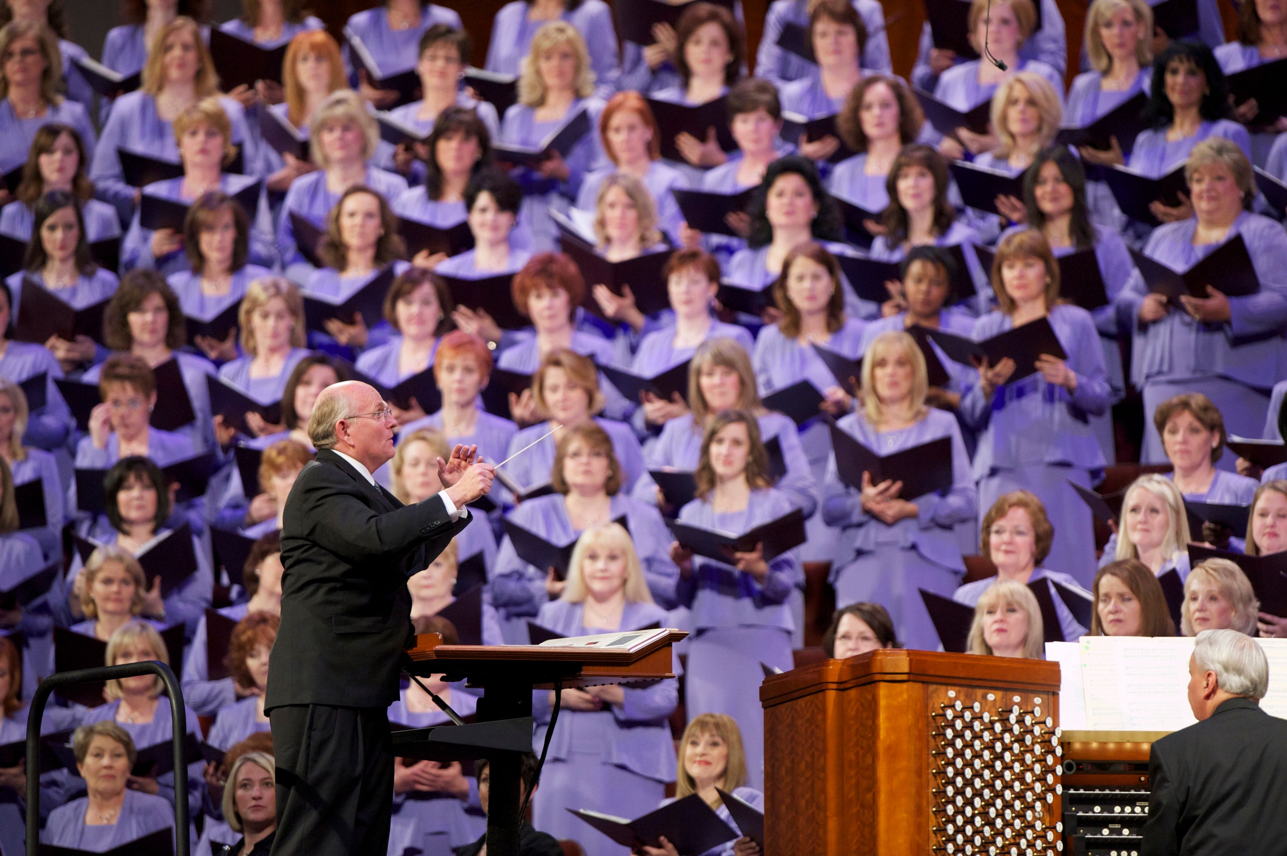 The Mormon Tabernacle Choir conductor leads the choir during general conference.