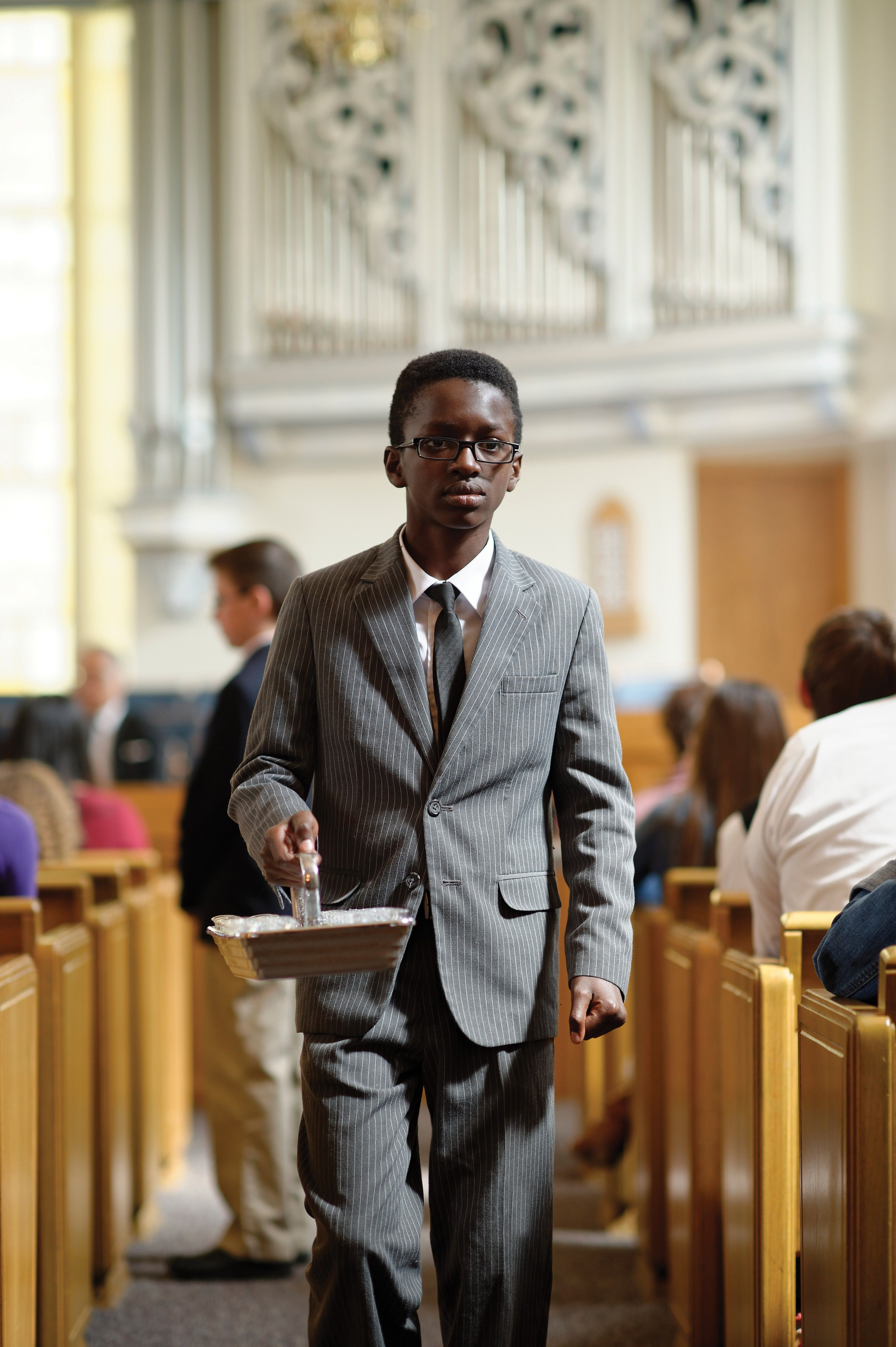A deacons passing the sacrament to members of the congregation.
