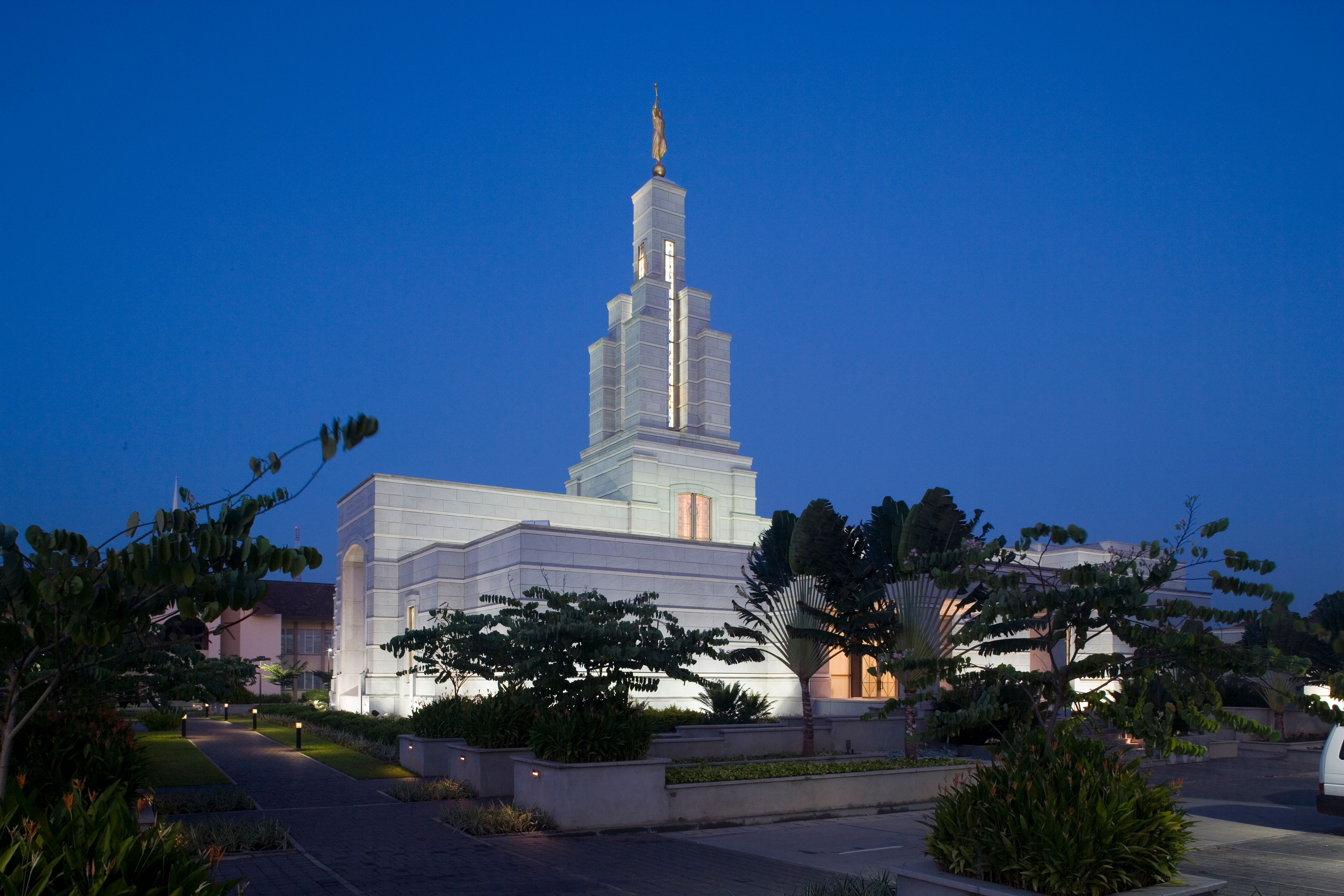 The Accra Ghana Temple and grounds are lit up at night.