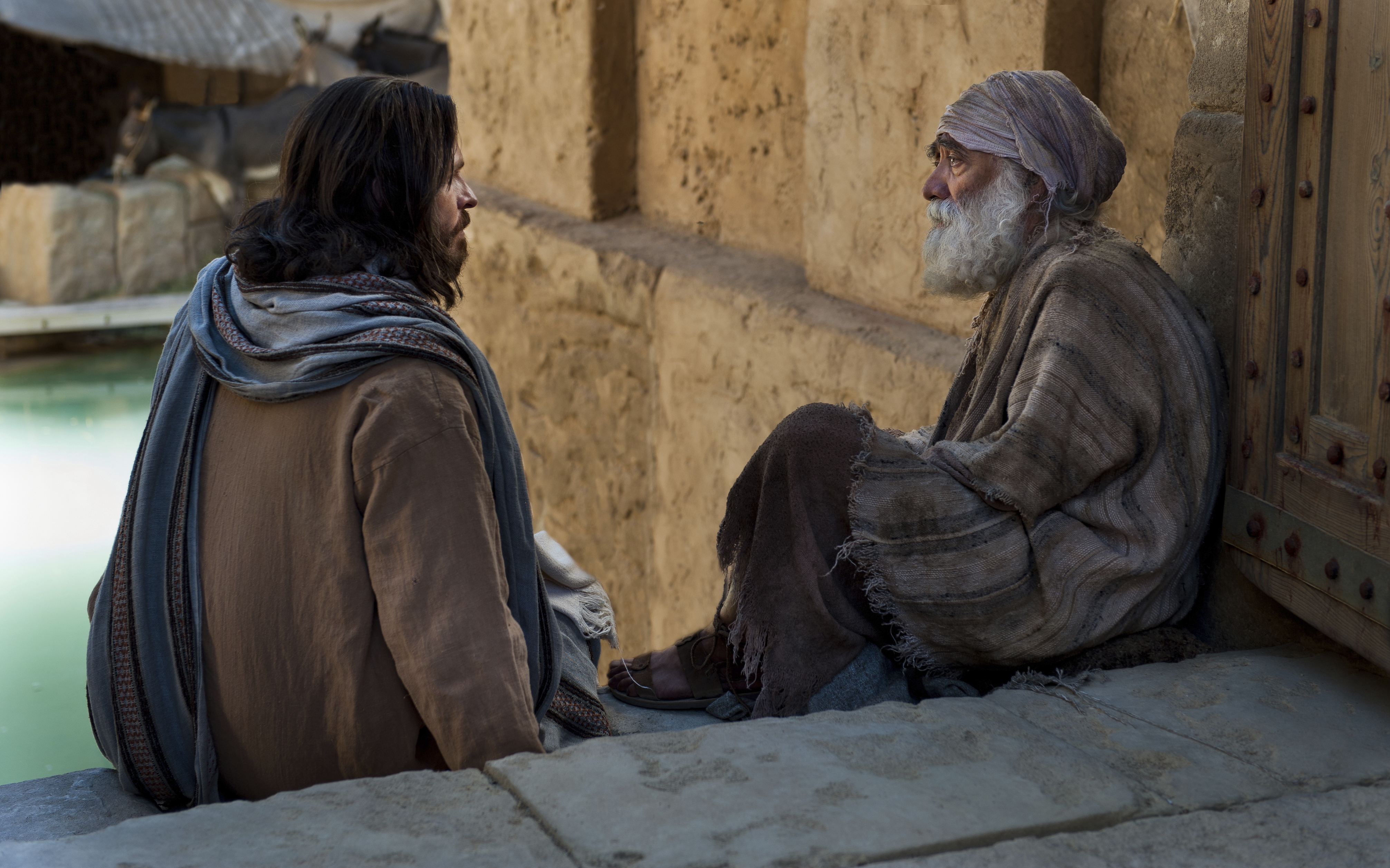 Christ speaking with a disabled man on the stairs of the pool of Bethesda.