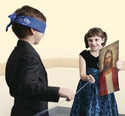 blindfolded boy following a string