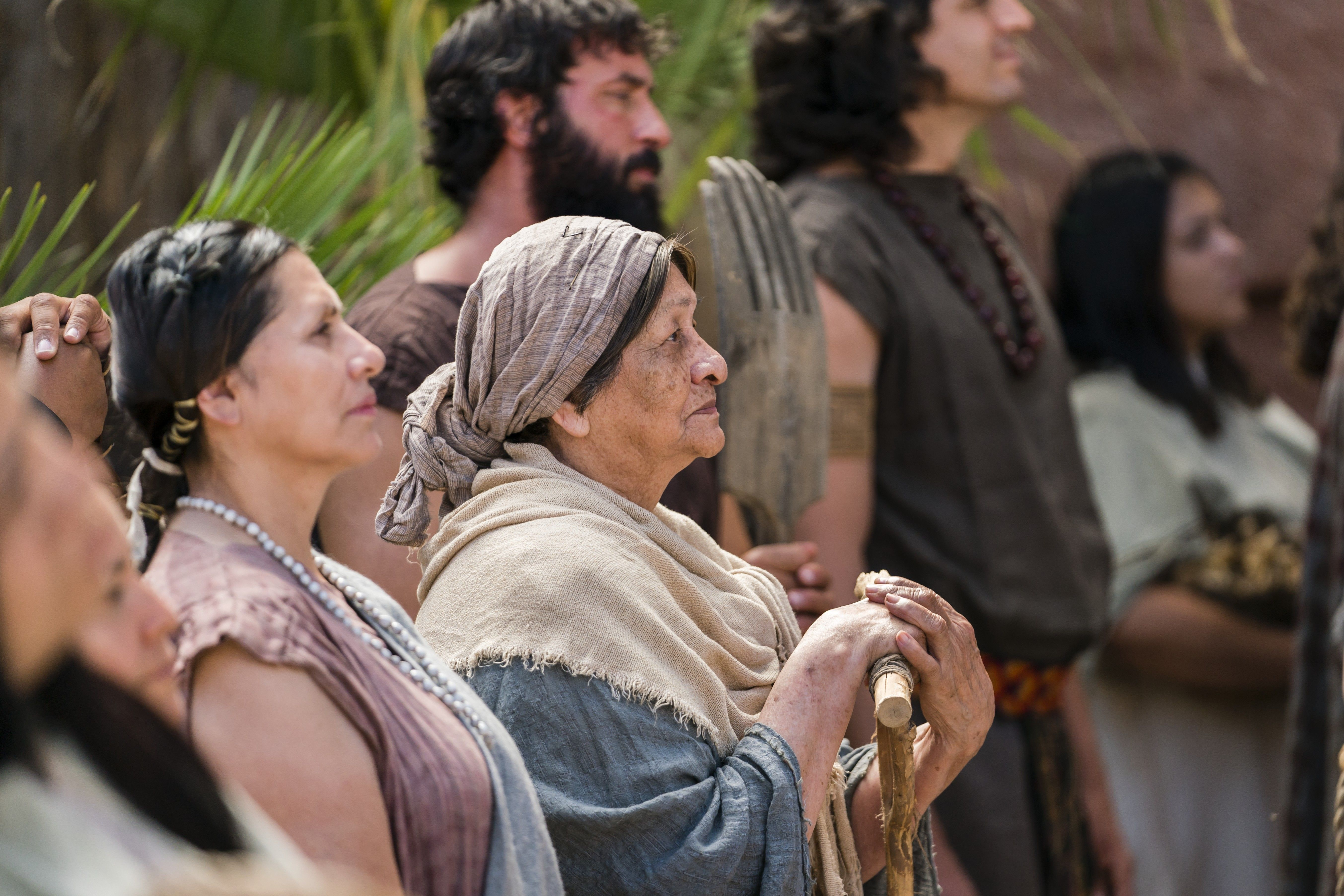 An elderly woman listens as Alma the Younger preaches to the people of Gideon.