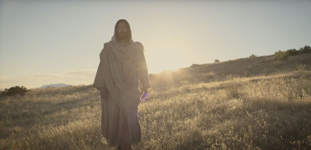 Jesus Christ walking through a field invites all to come unto Him