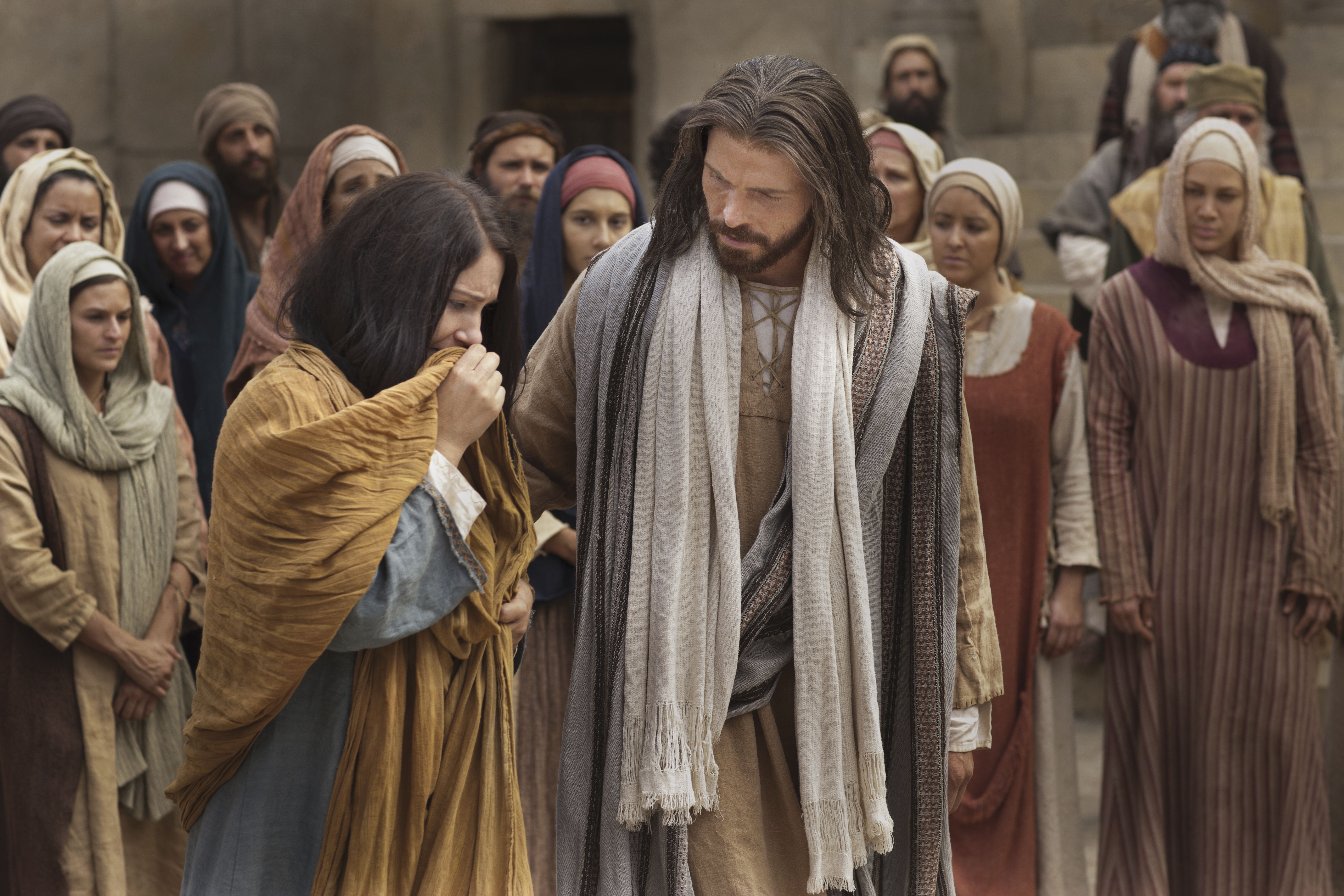 Jesus walking and talking with the woman taken in adultery.