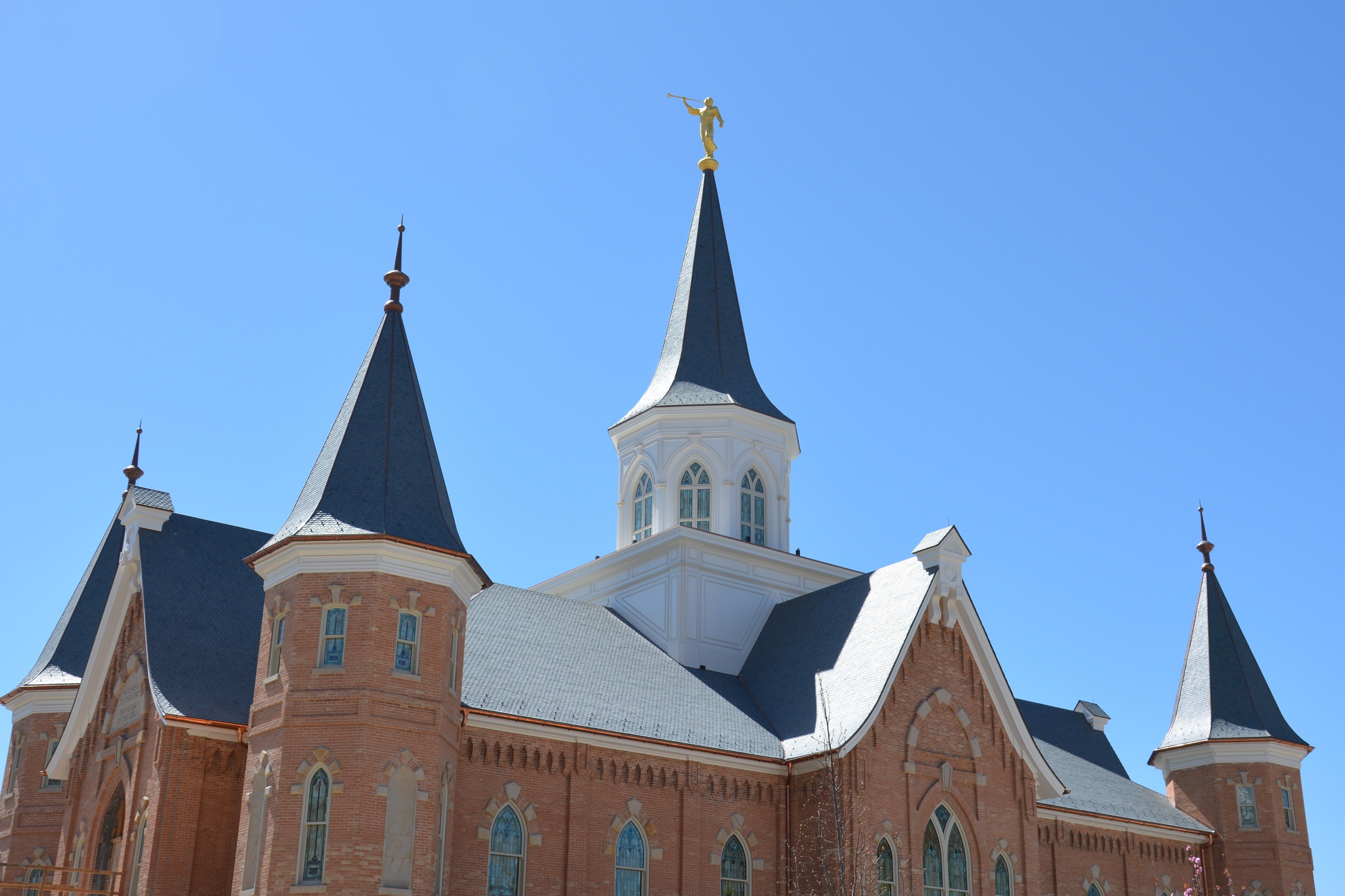 A side view of the Provo City Center Temple with a clear sky overhead.