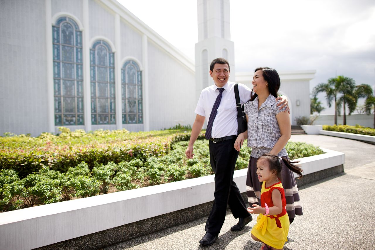 A young family walk to church