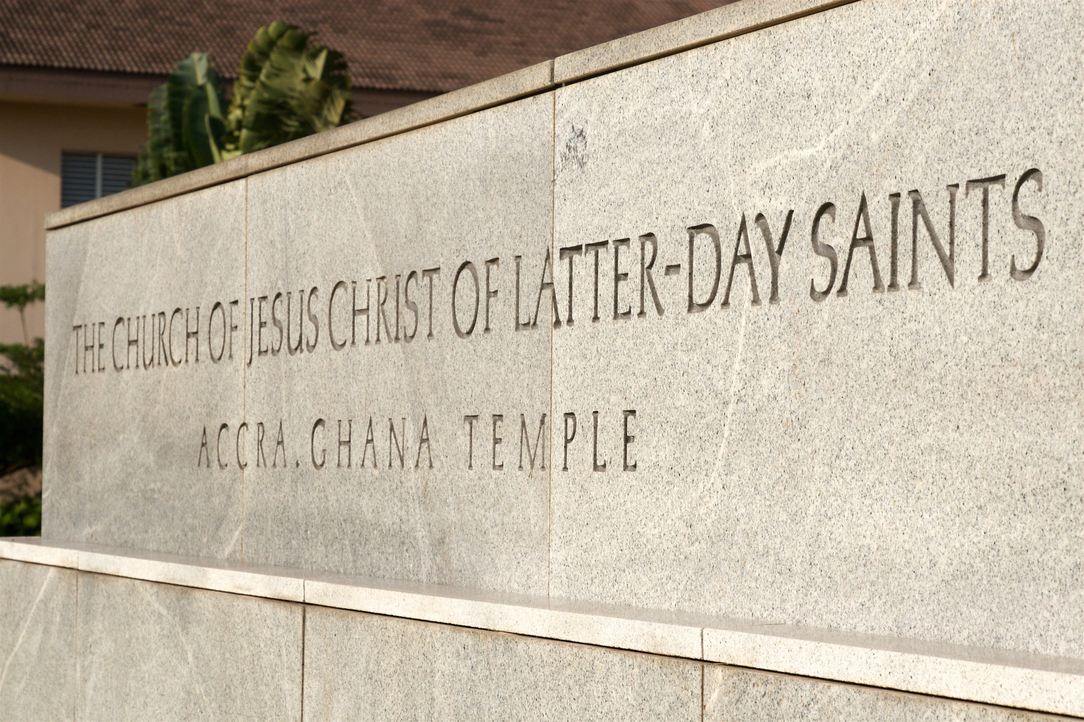 The temple name sign greets members as they come to the Accra Ghana Temple.