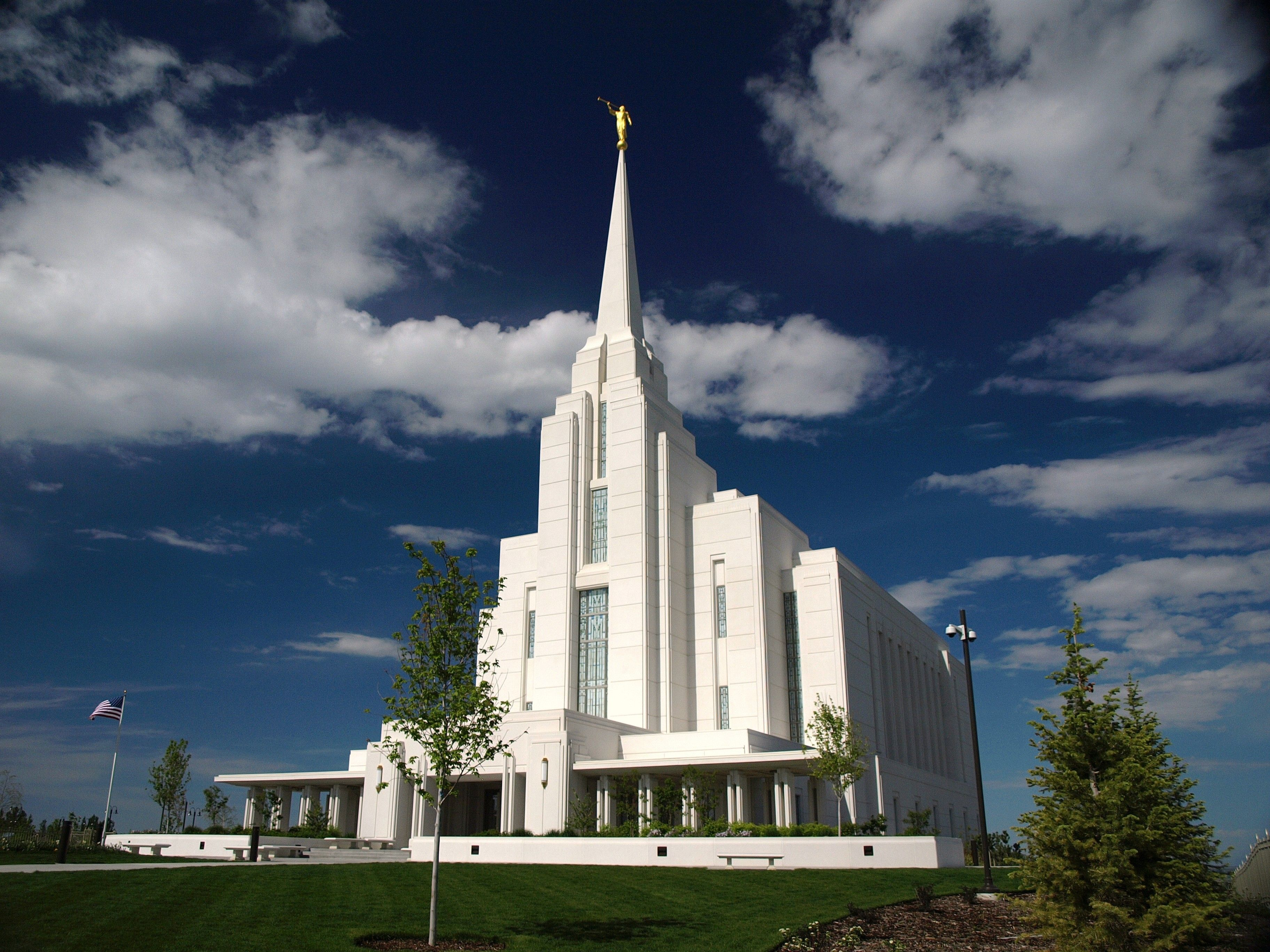The Rexburg Idaho Temple on a partly cloudy day.