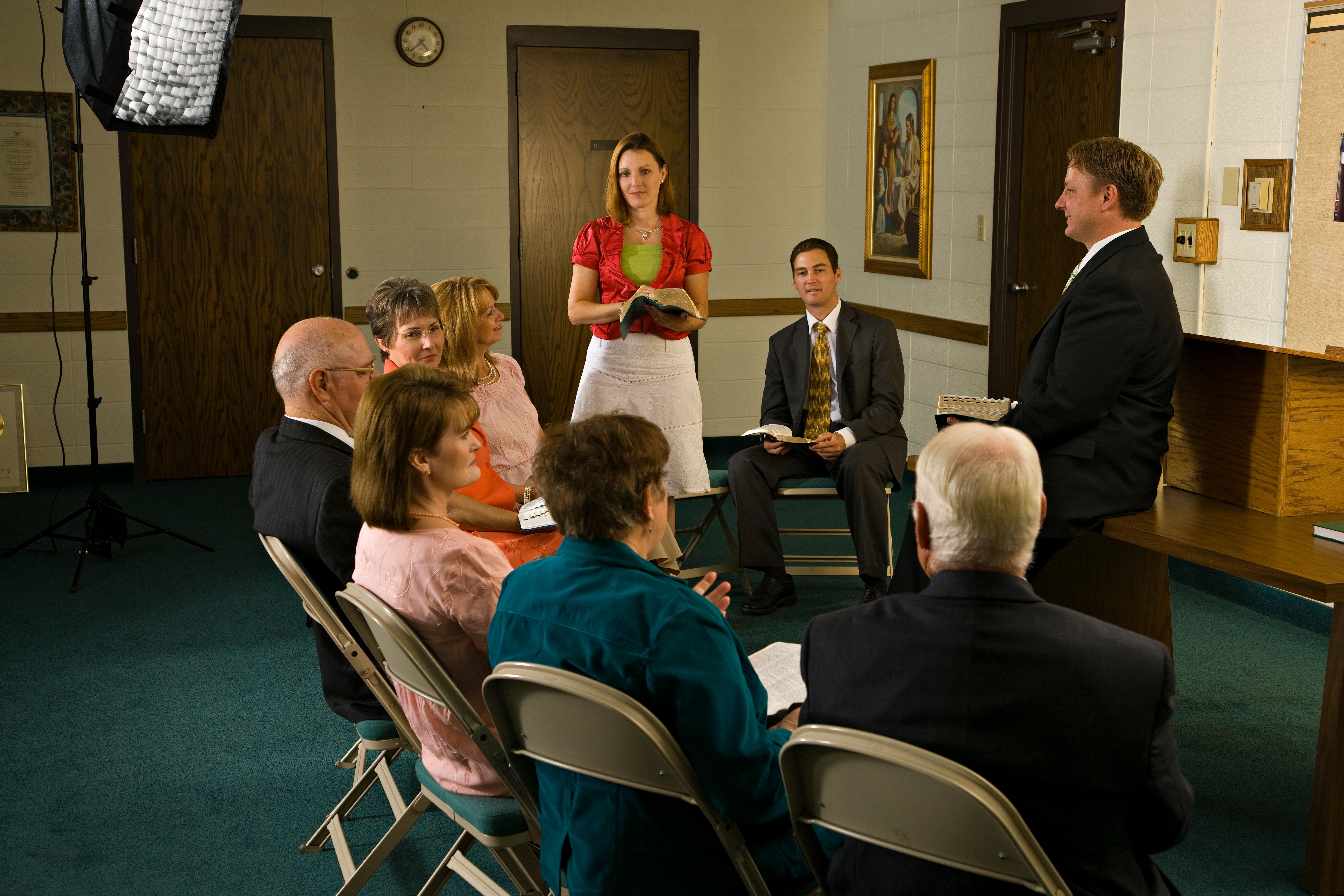 Adults sitting in a circle in Sunday School.