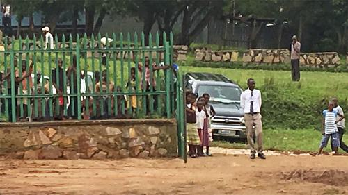 Children outside fence