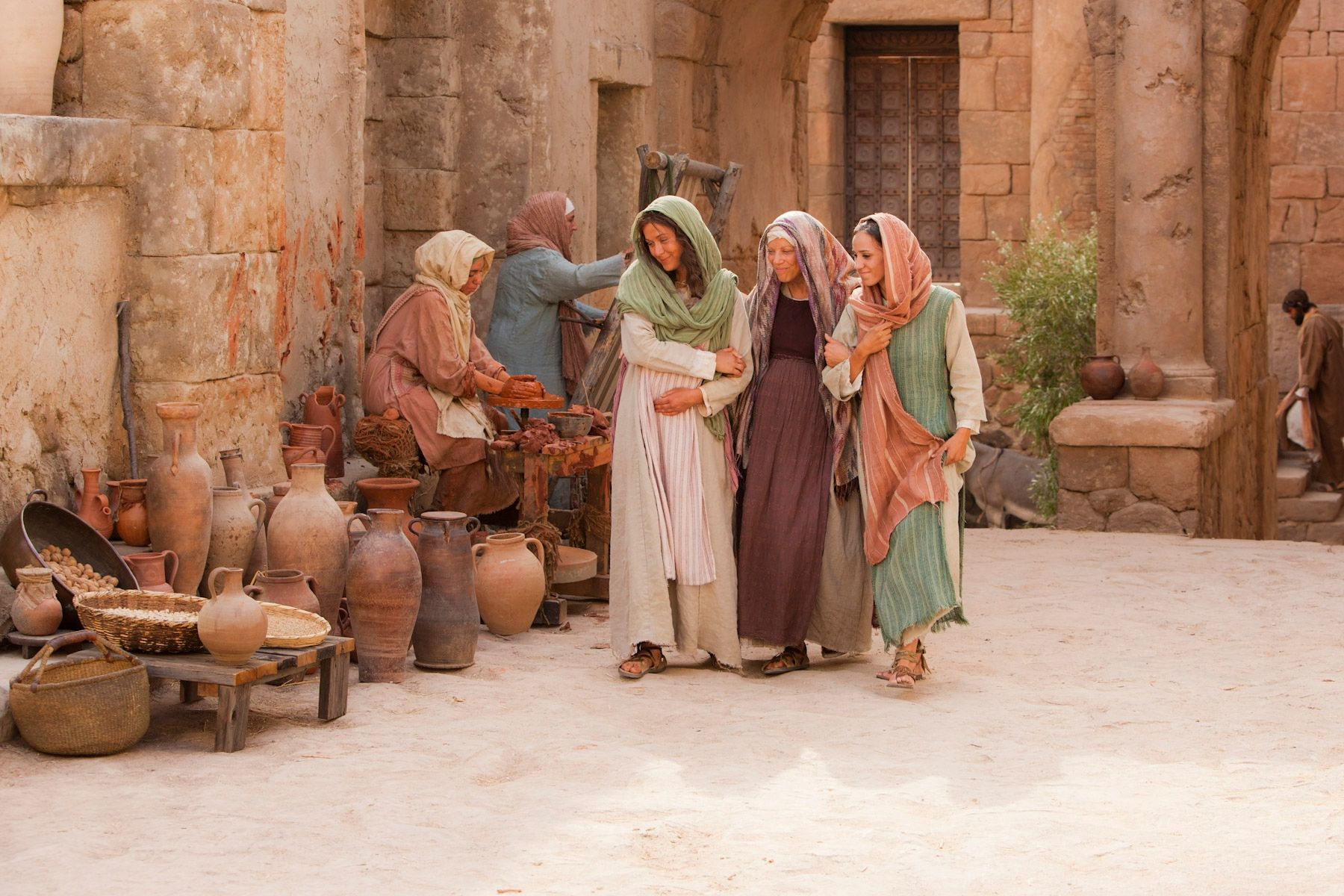 Mary walks through the streets with her cousin, Elisabeth.