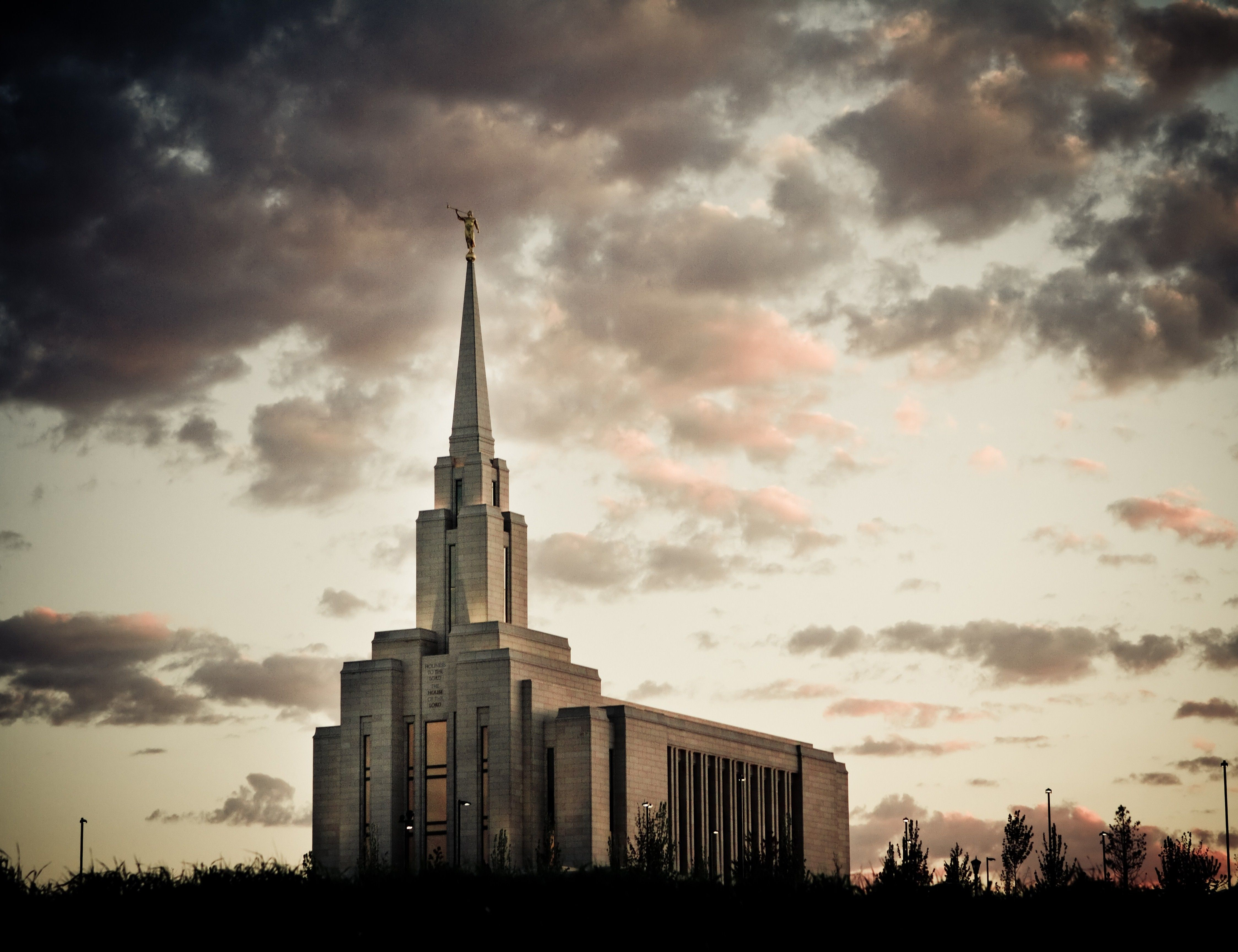 The Oquirrh Mountain Utah Temple in the evening, including scenery.