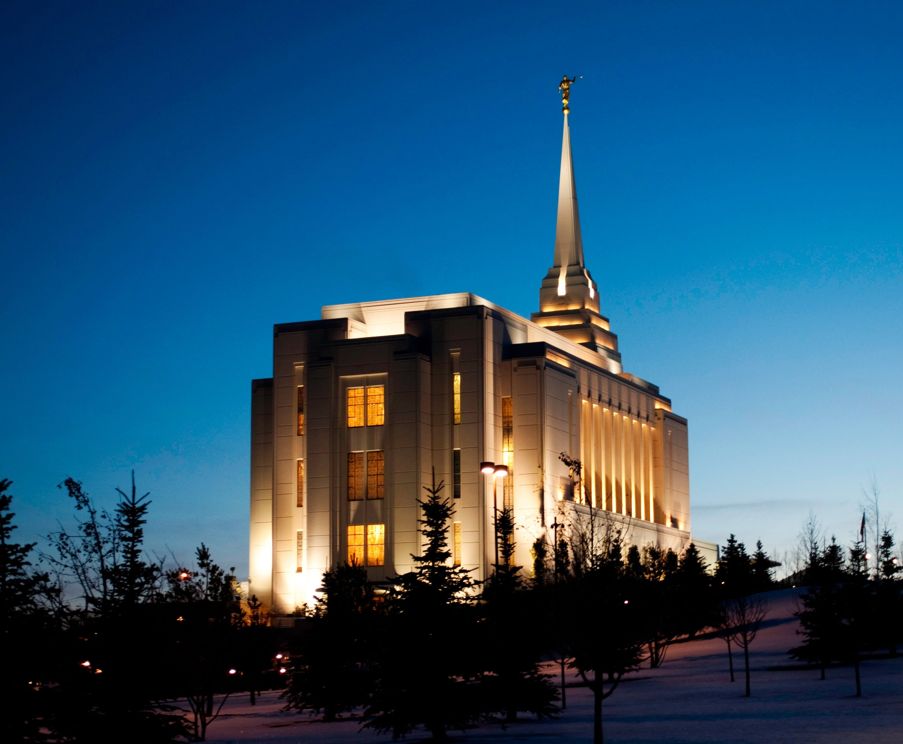 The Rexburg Idaho Temple west side in the evening, including scenery.