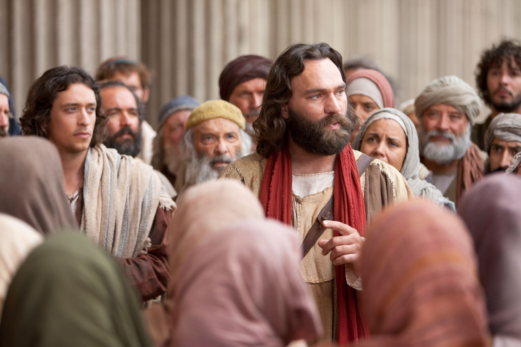 Peter preaches of Christ to those who will listen.