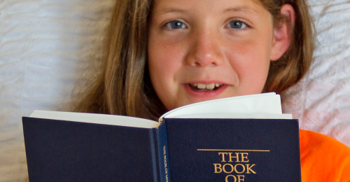 Girl with Book of Mormon