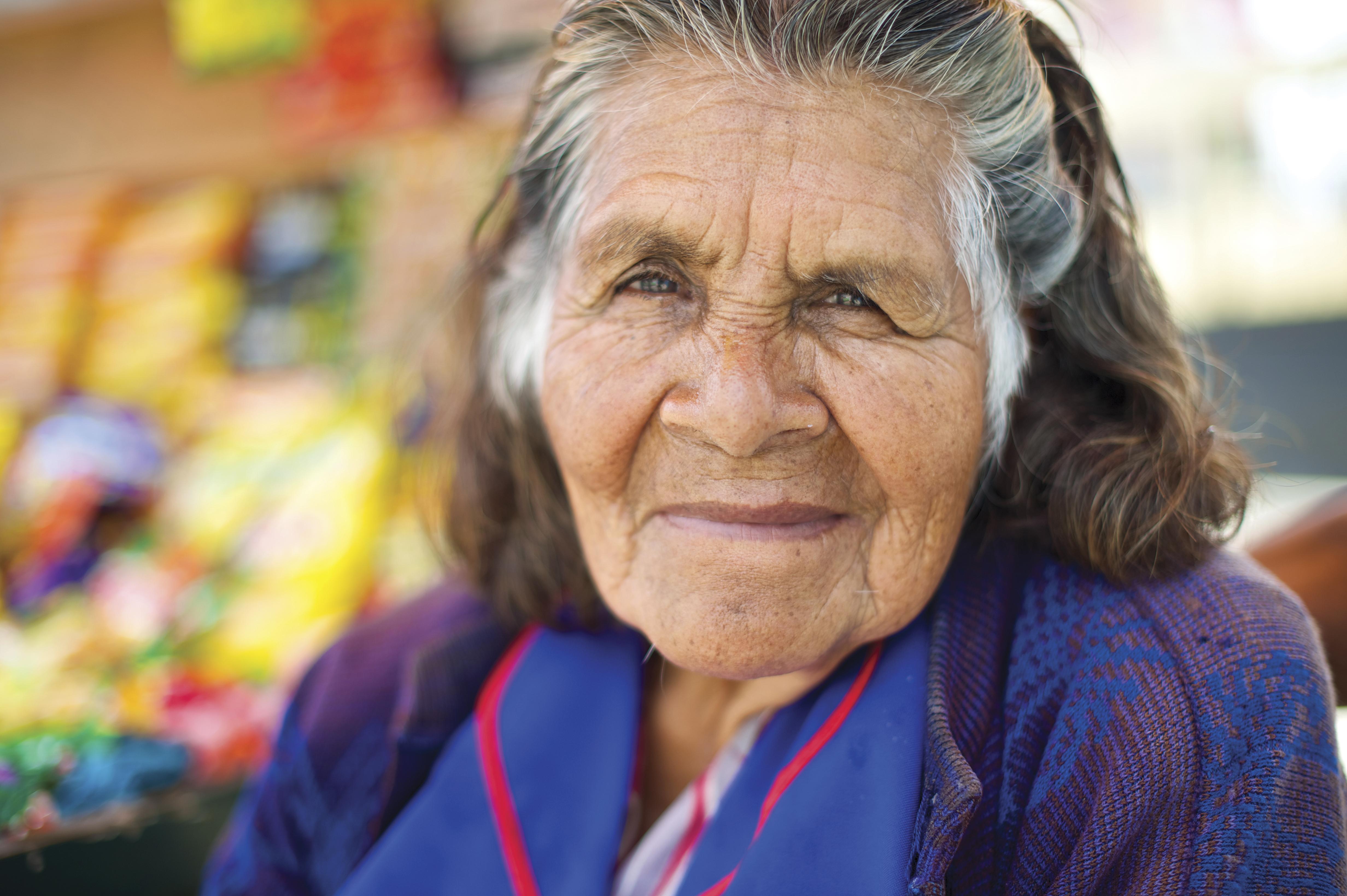 An informal portrait of an elderly woman in Peru.