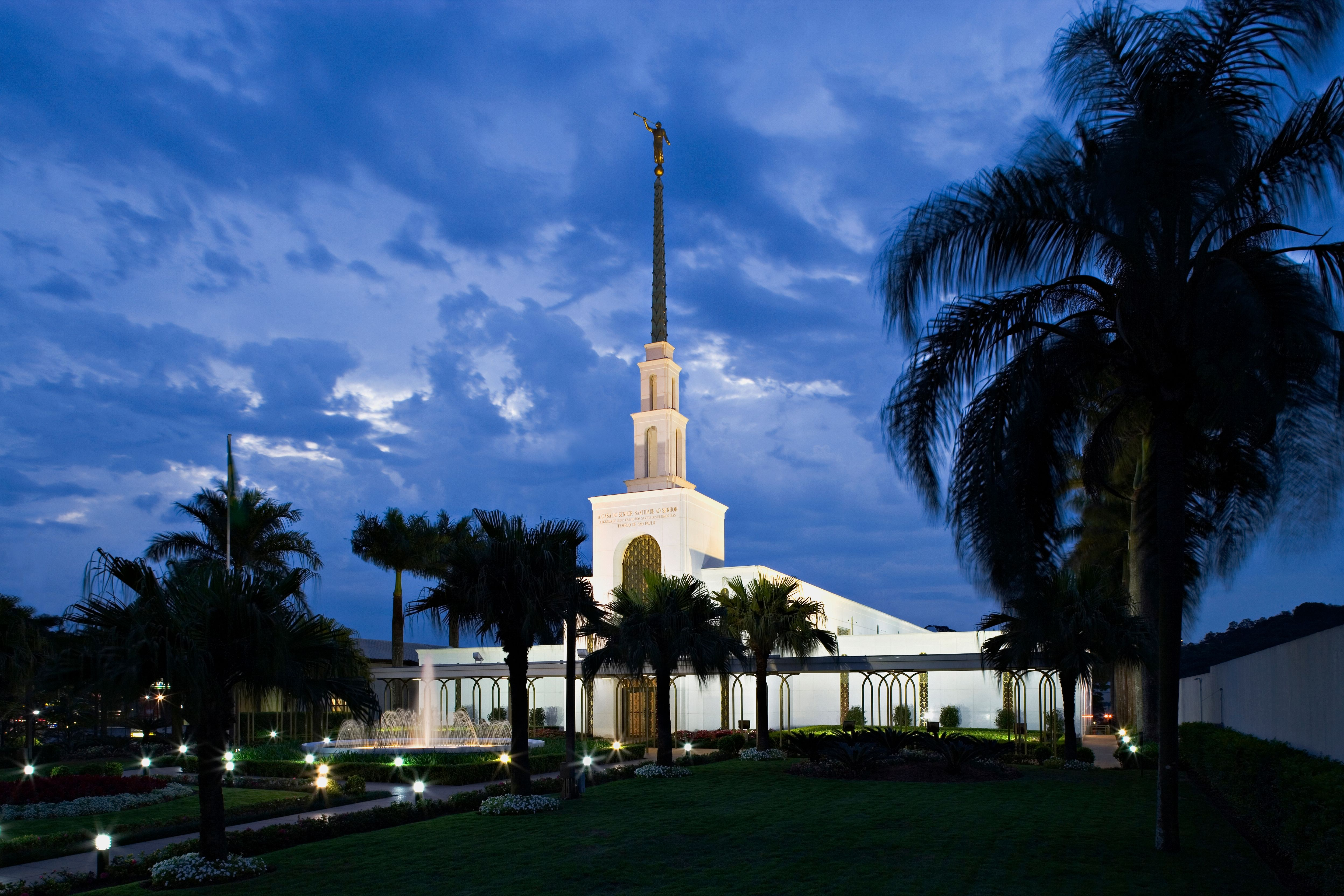 The São Paulo Brazil Temple in the evening, including the entrance and scenery.