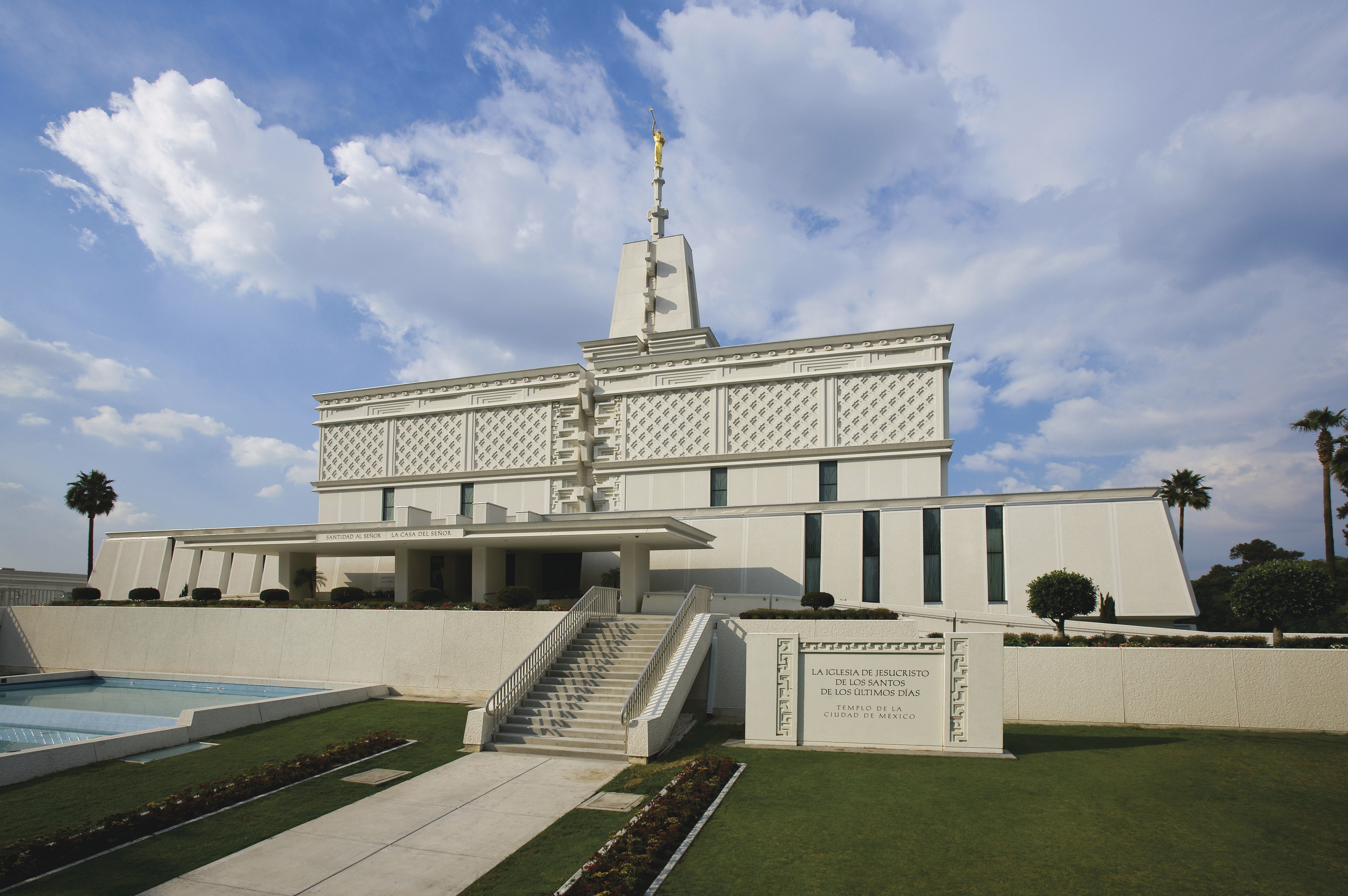 The front entrance of the Mexico City Mexico Temple on a partly cloudy day.
