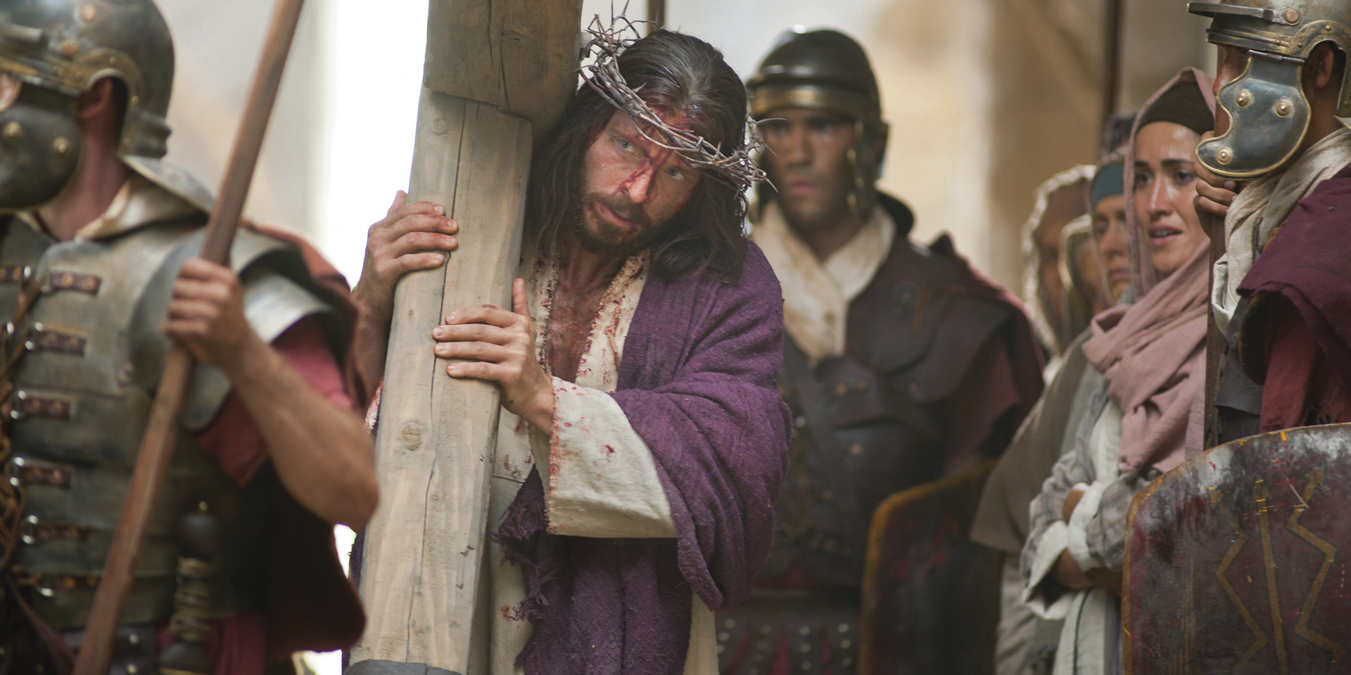 Jesus carries His cross on the way to His Crucifixion.