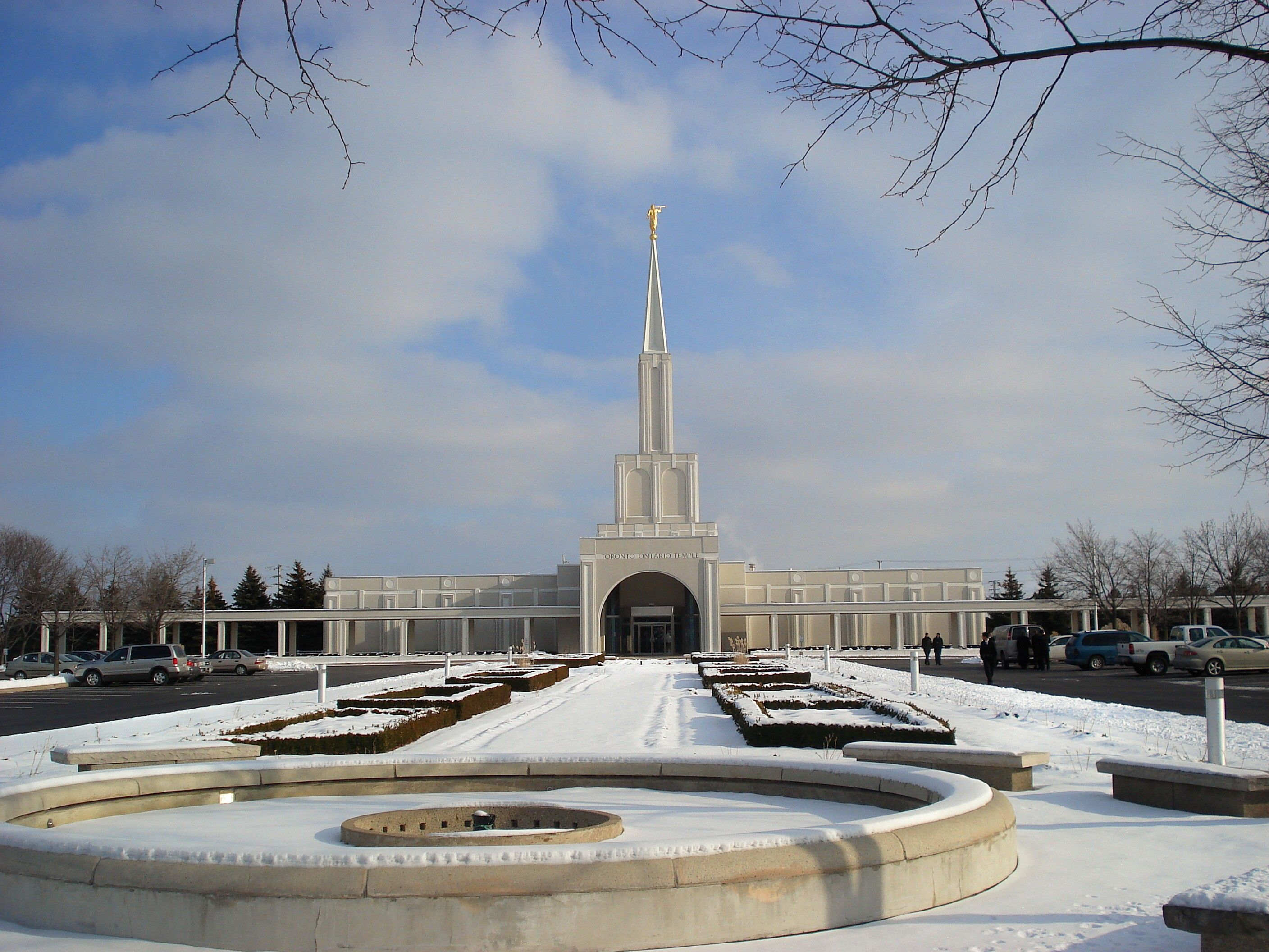 The Toronto Ontario Temple in the winter, including the fountain, entrance, and scenery.
