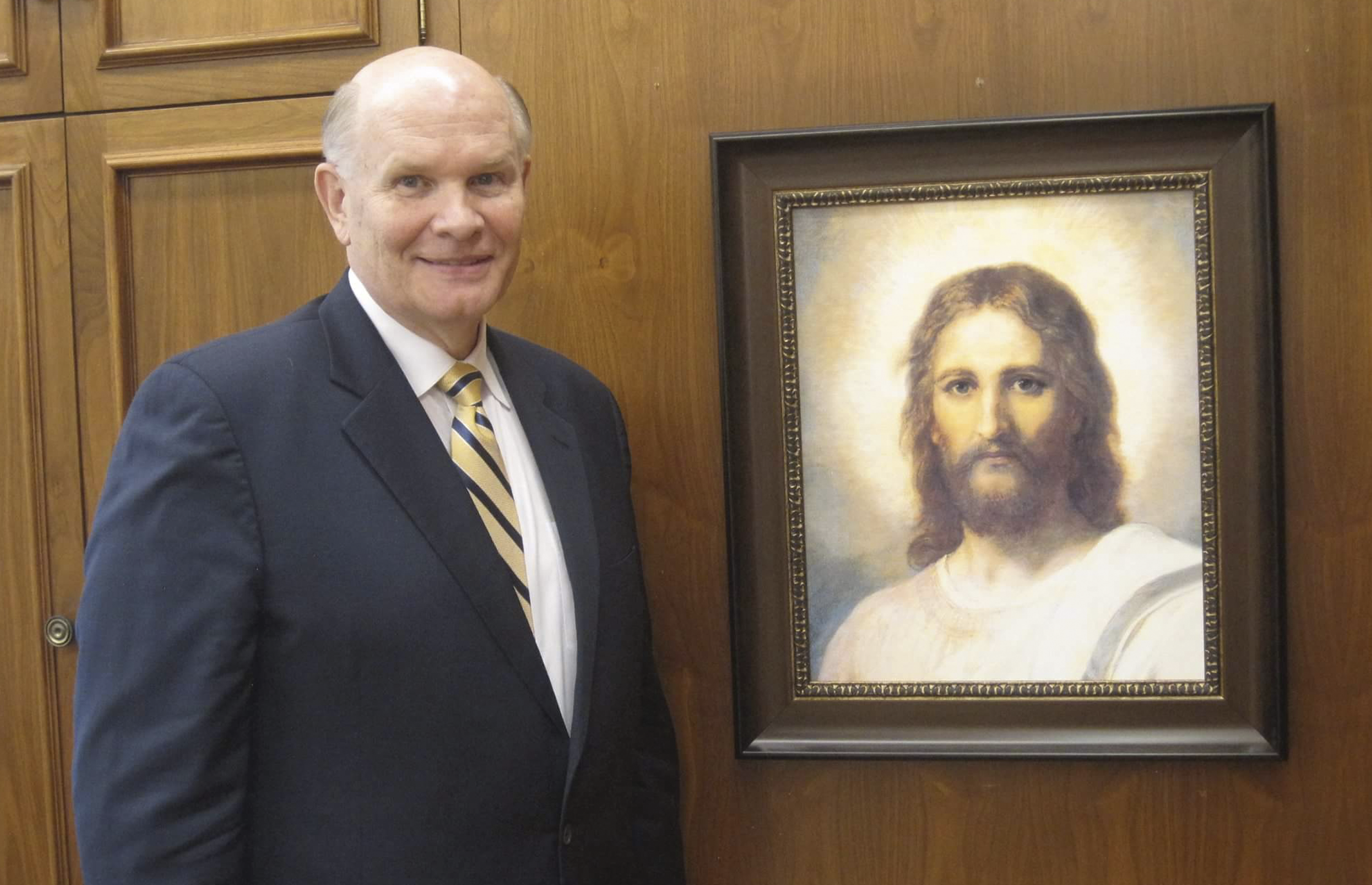 Dale G. Renlund with painting of Savior