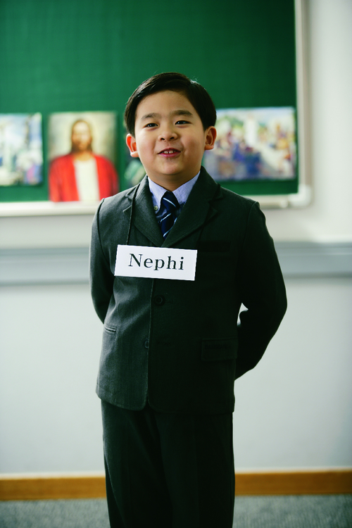 young boy wearing the name Nephi around his neck