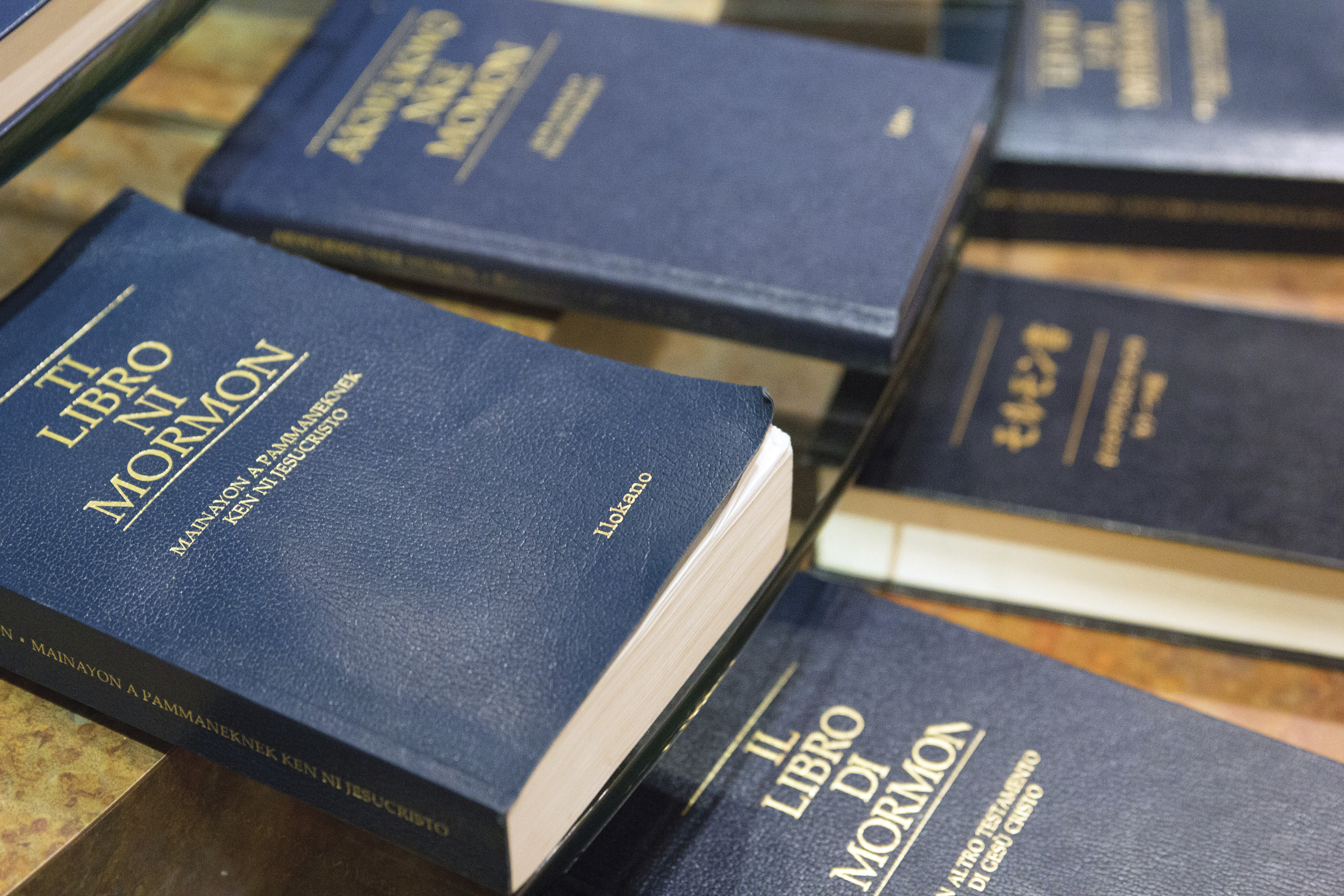 Copies of the Book of Mormon in a variety of languages at the Independence Visitors' Center in Missouri.