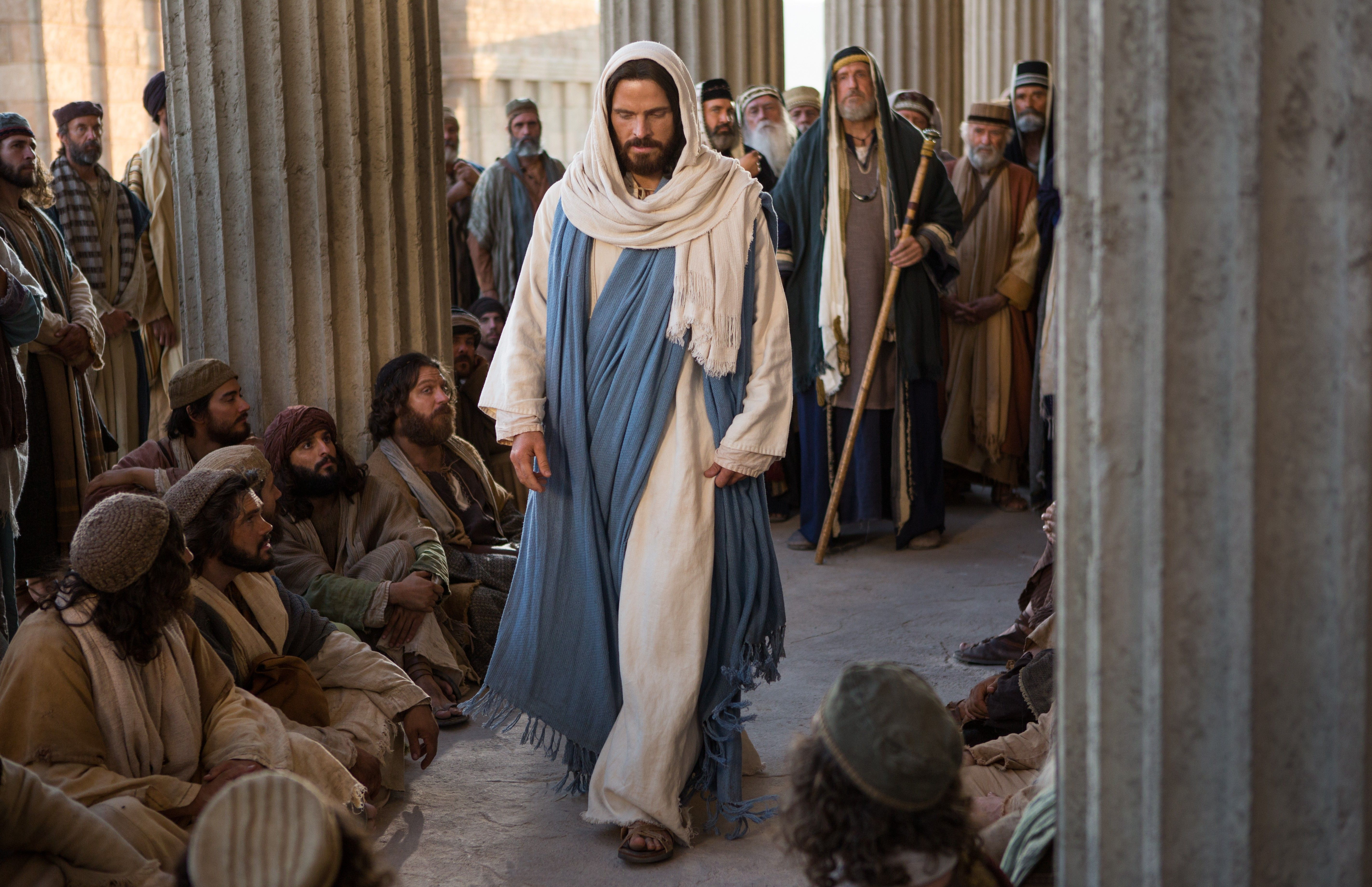 Jesus teaches Pharisees as they question Him.
