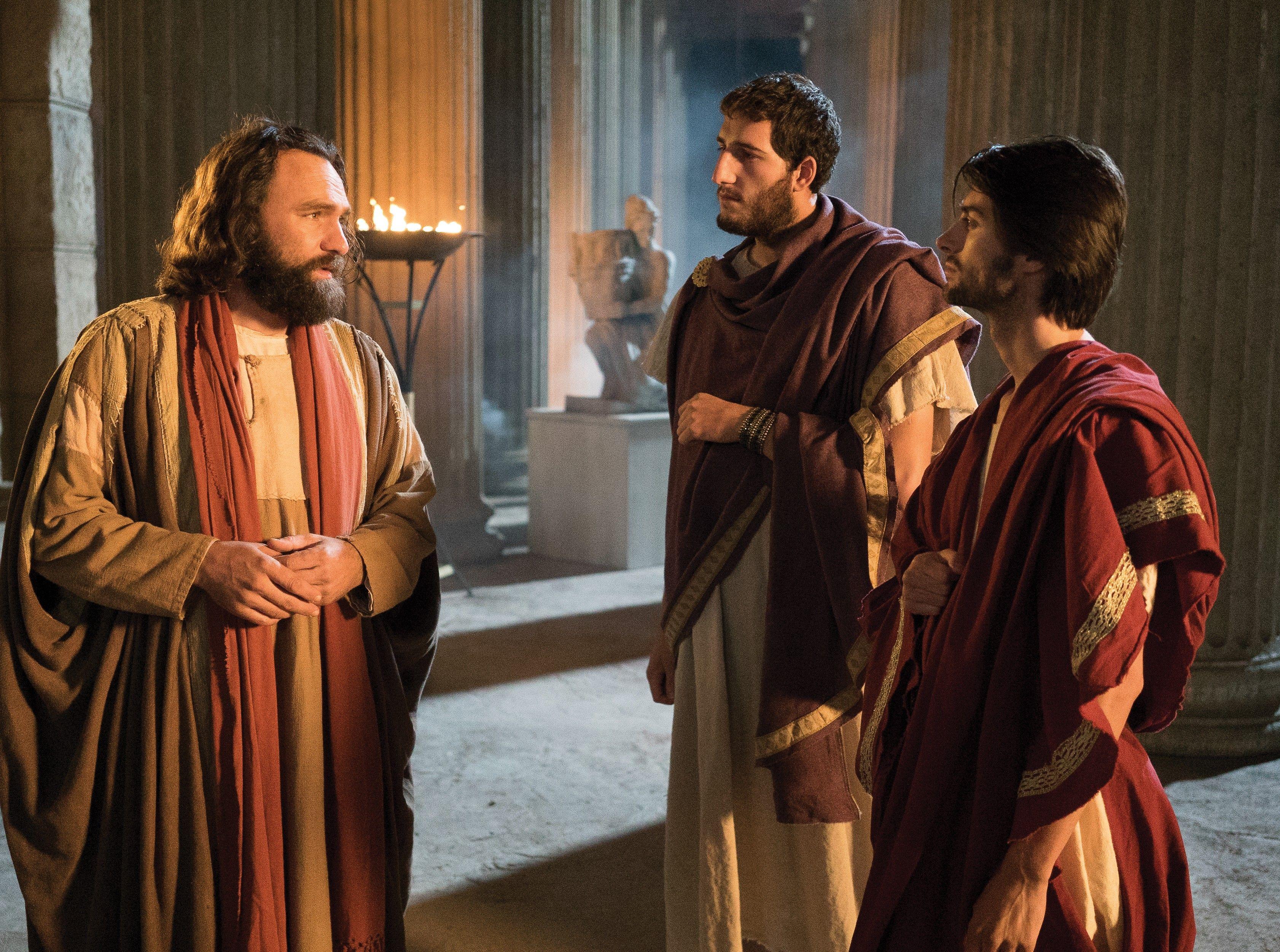 Peter teaching two men.