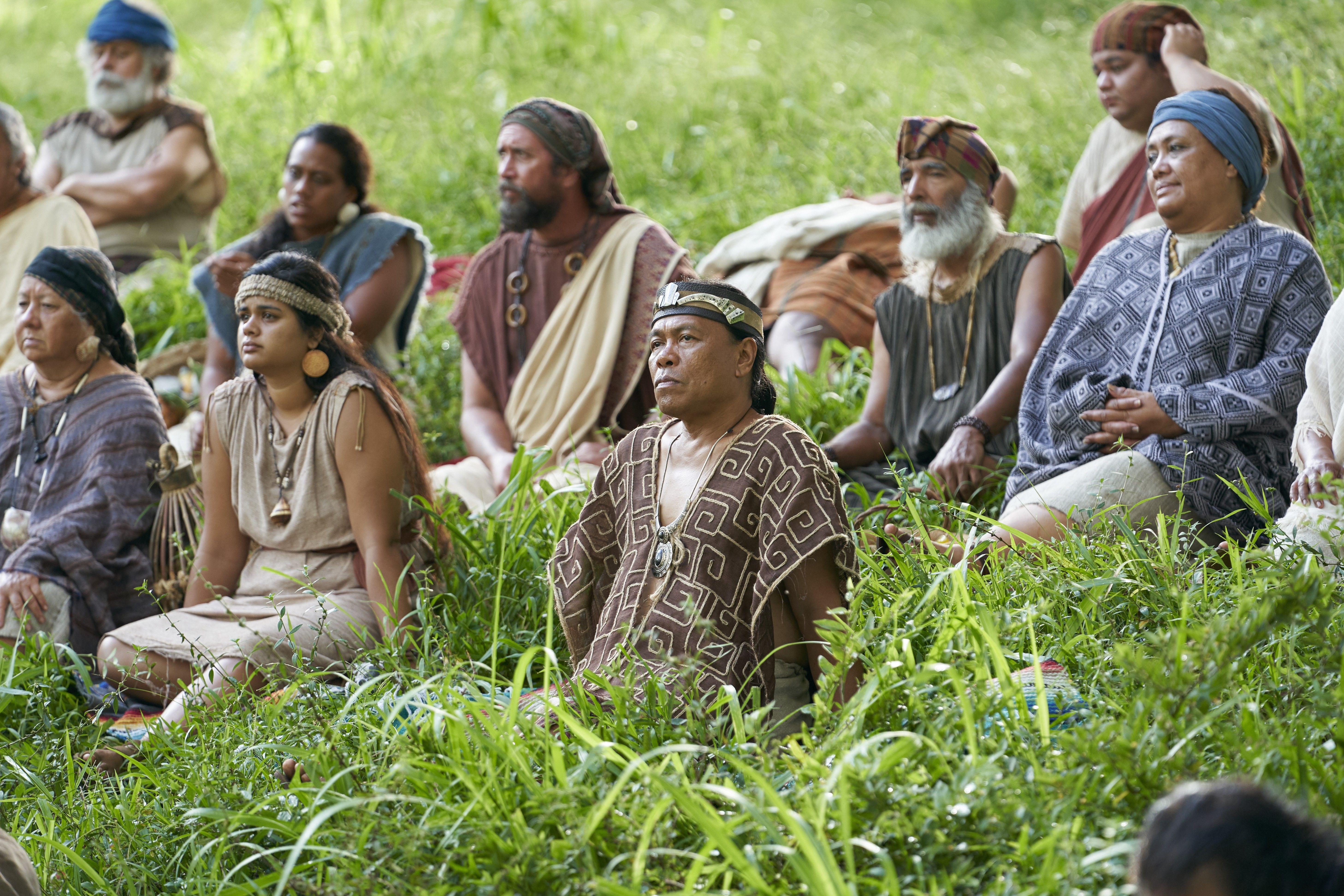 A rich Zoramite listens as Alma the Younger and Amulek preach in the land of Antionum.