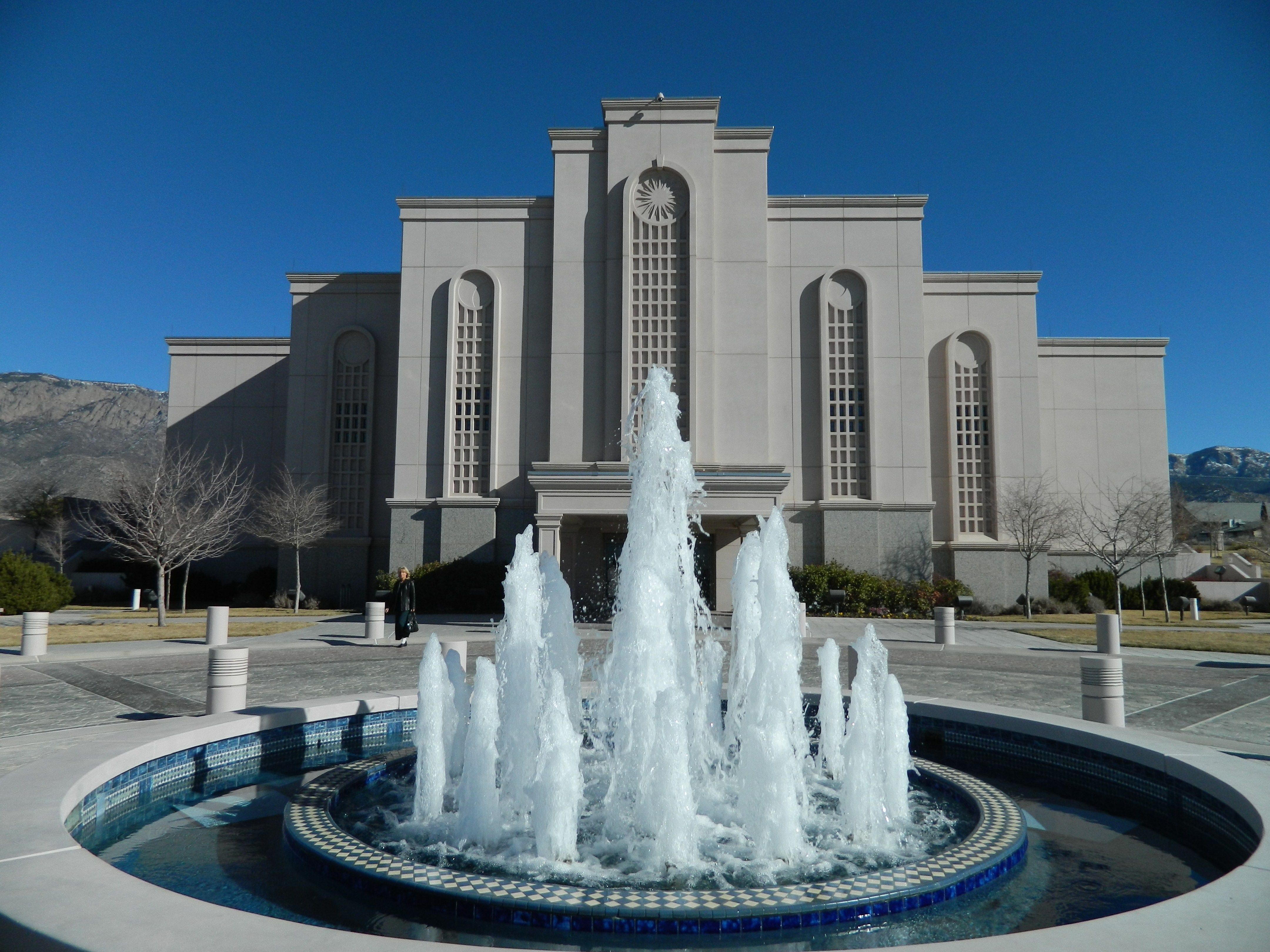 In front of the Albuquerque New Mexico Temple is a large fountain.