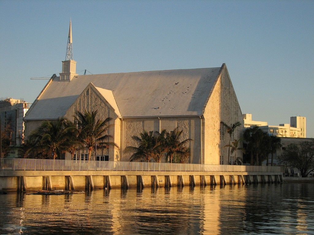 A chapel in Miami, Florida, reflected in nearby water.
