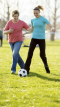 older woman and young woman playing soccer