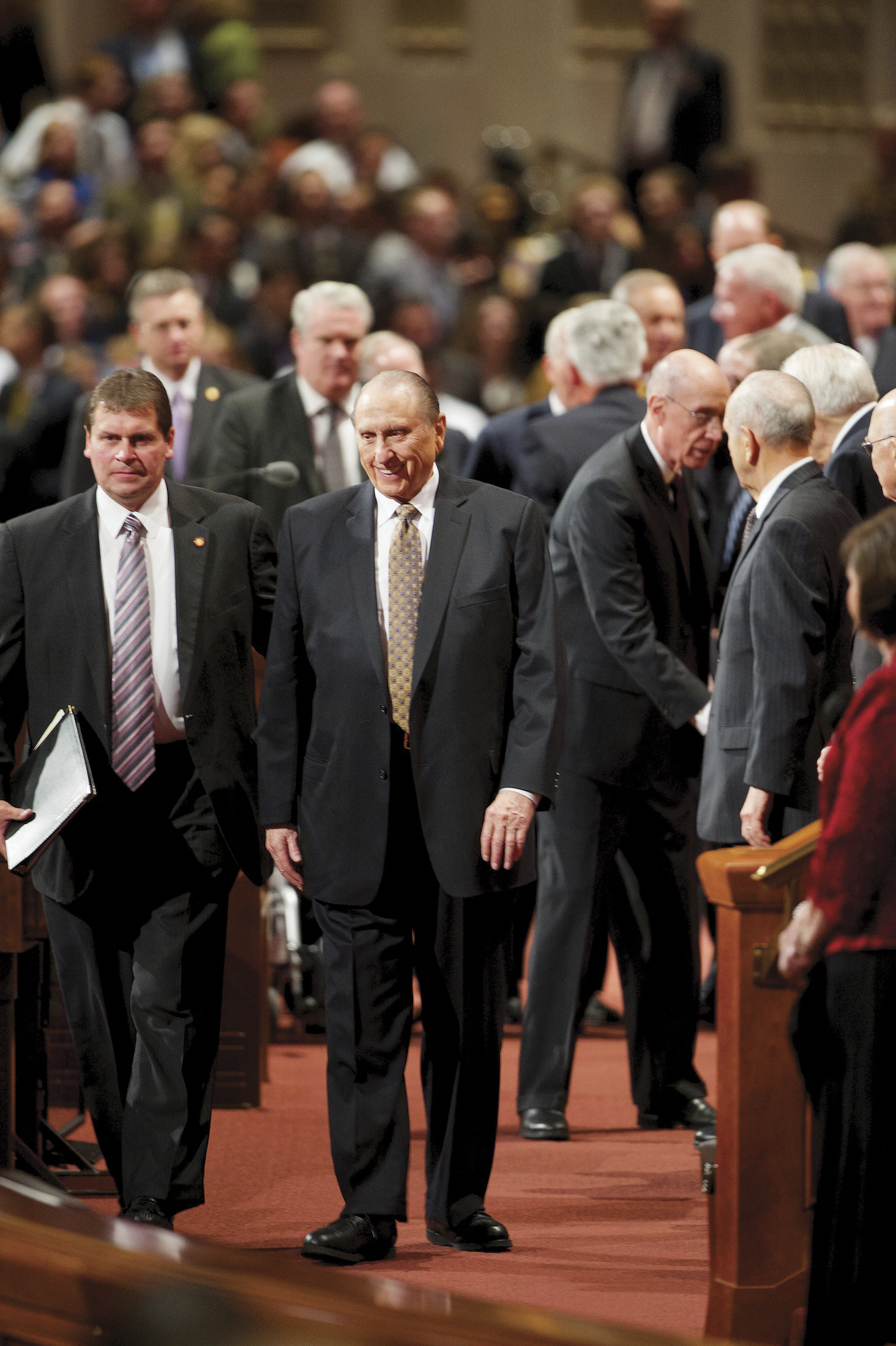 Thomas S. Monson exiting the Conference Center with his security guard.