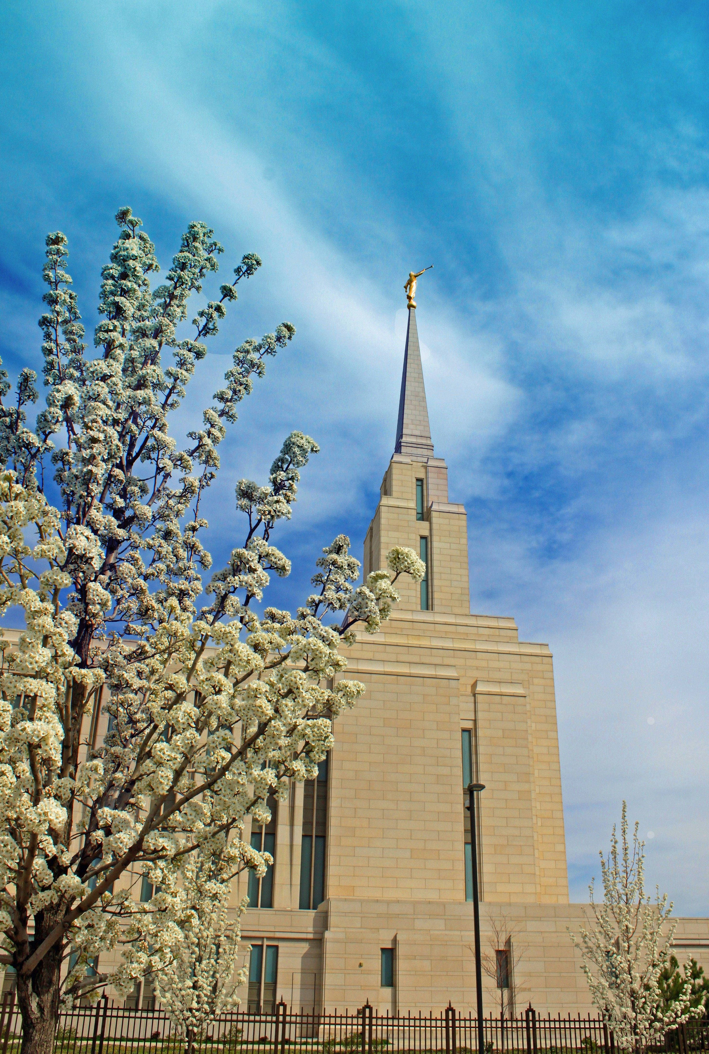 The Oquirrh Mountain Utah Temple spire, including scenery.