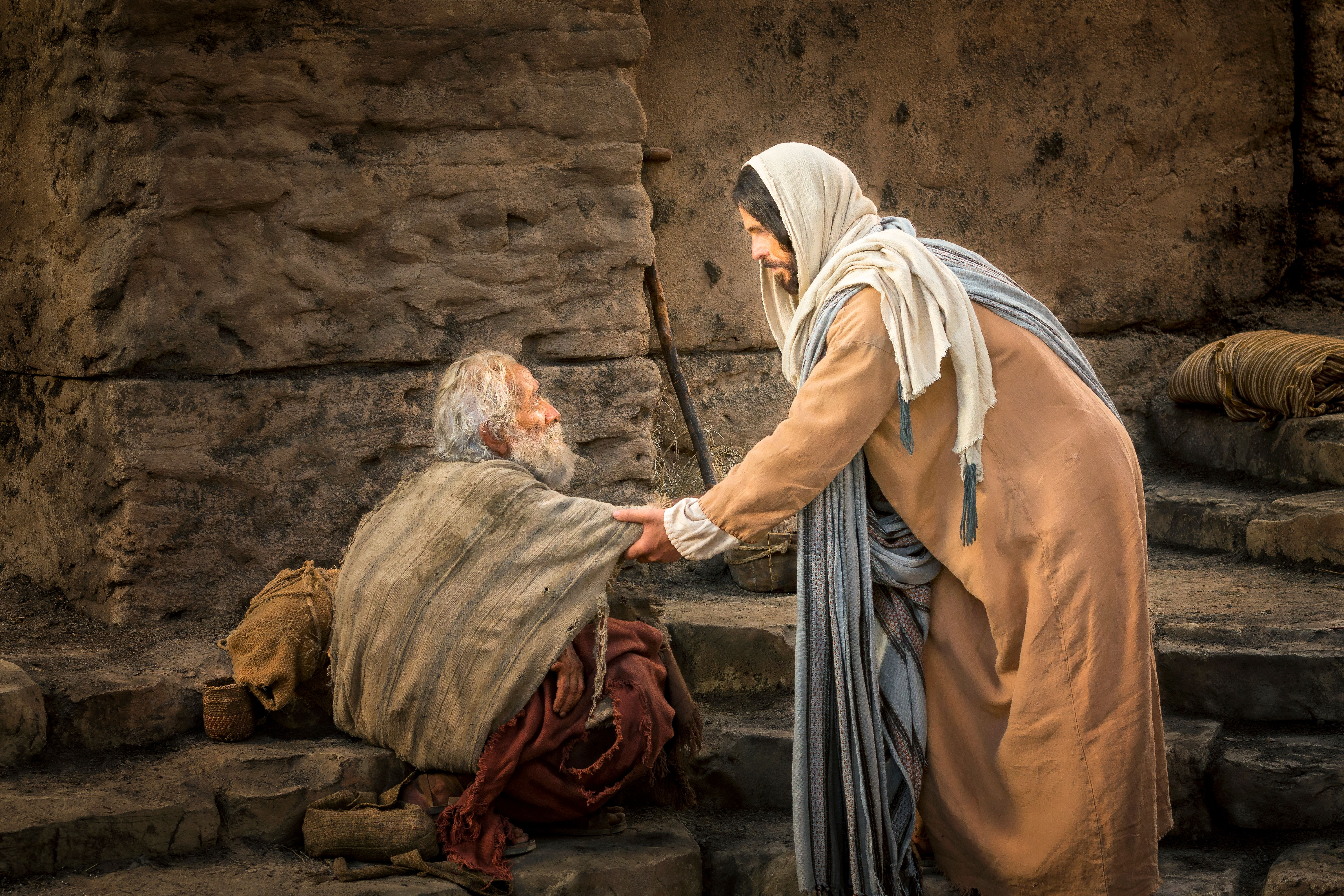 A man being healed by Christ at the pool of Bethesda.