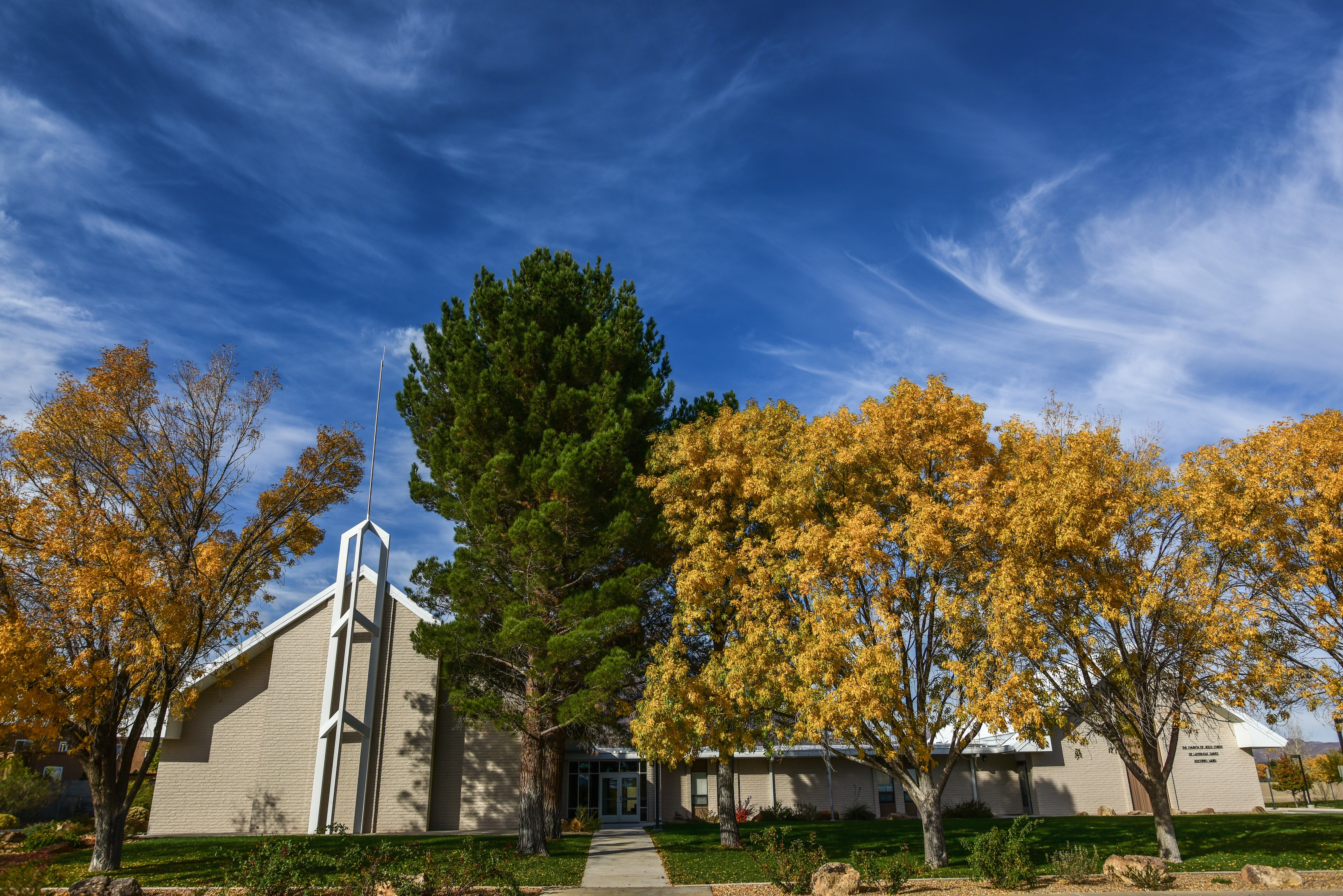 A chapel hidden behind trees in Socorro, New Mexico.