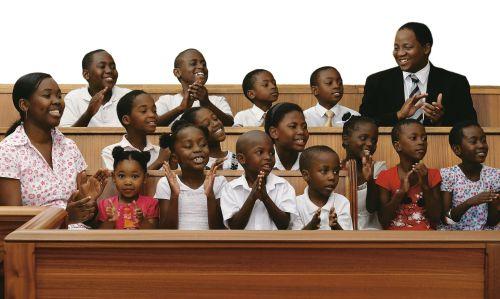children and teachers in chapel