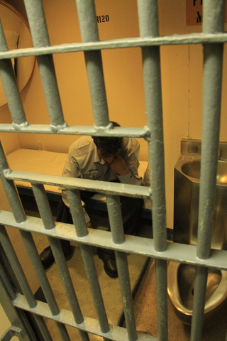 Man in Prison Cell