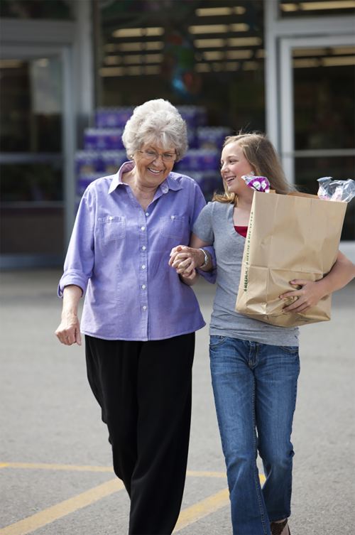 Young Woman helping with groceries
