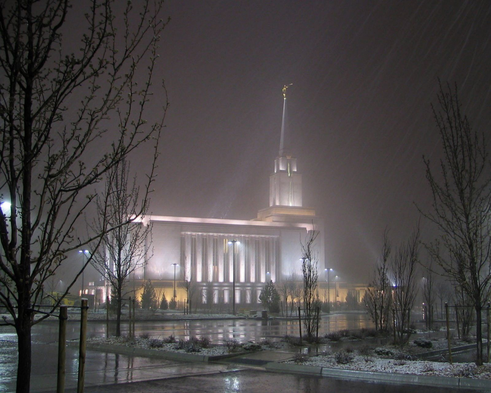 The Oquirrh Mountain Utah Temple in the evening during winter, including scenery.