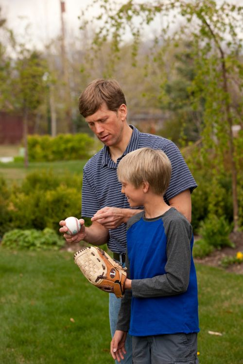Father and Son Play Baseball
