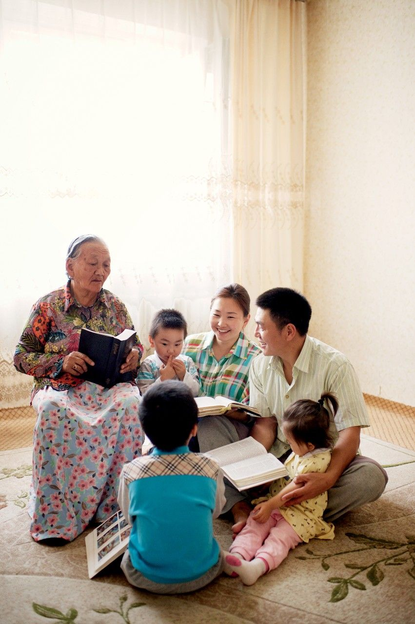 A family in Mongolia studies the scriptures together.