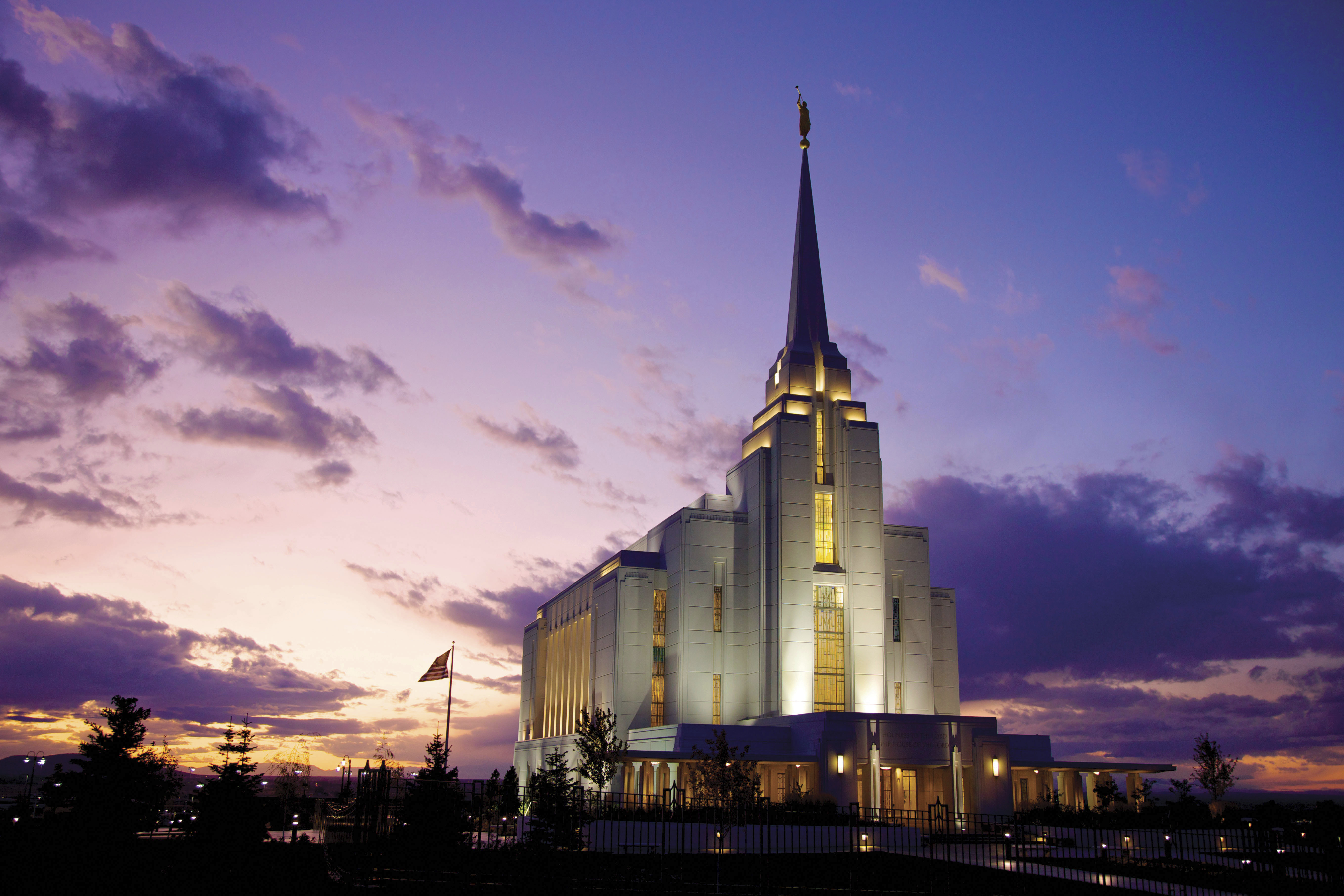 The Rexburg Idaho Temple in the evening, including scenery and clouds.