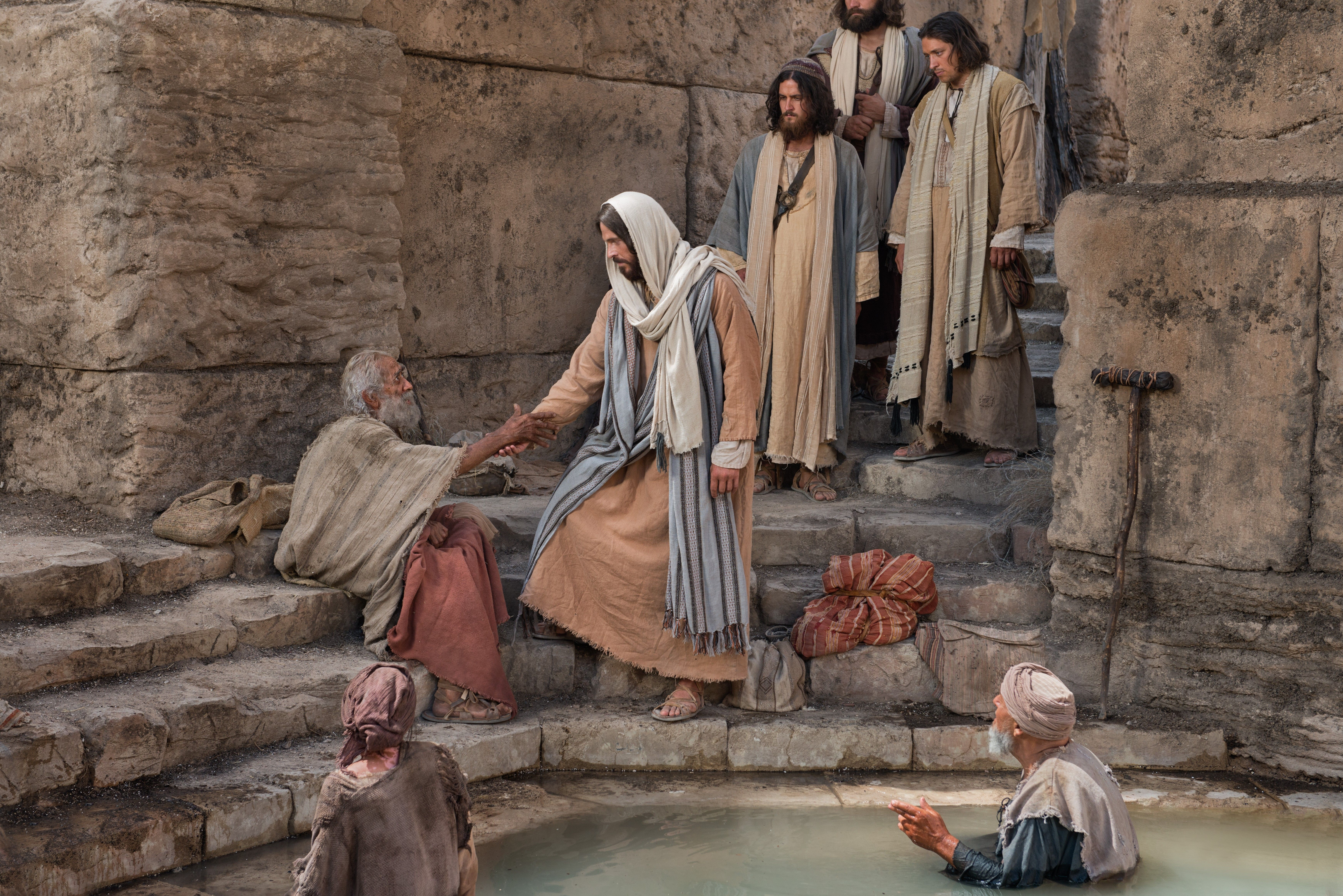 Christ at the pool of Bethesda, reaching toward the man waiting there.