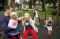 Family in playground in Latvia
